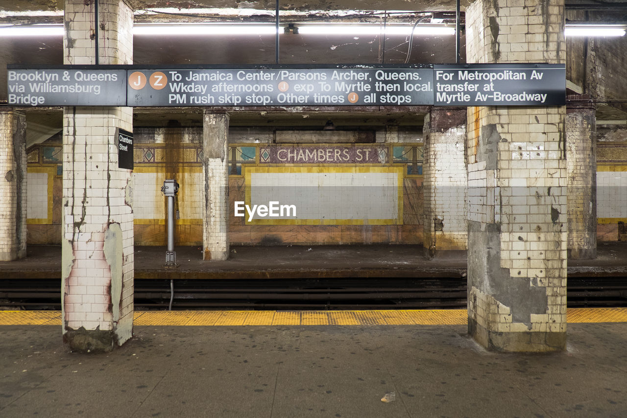 Sign board on columns at railroad station platform