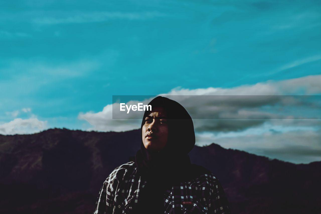 Portrait of women looking away against sky
