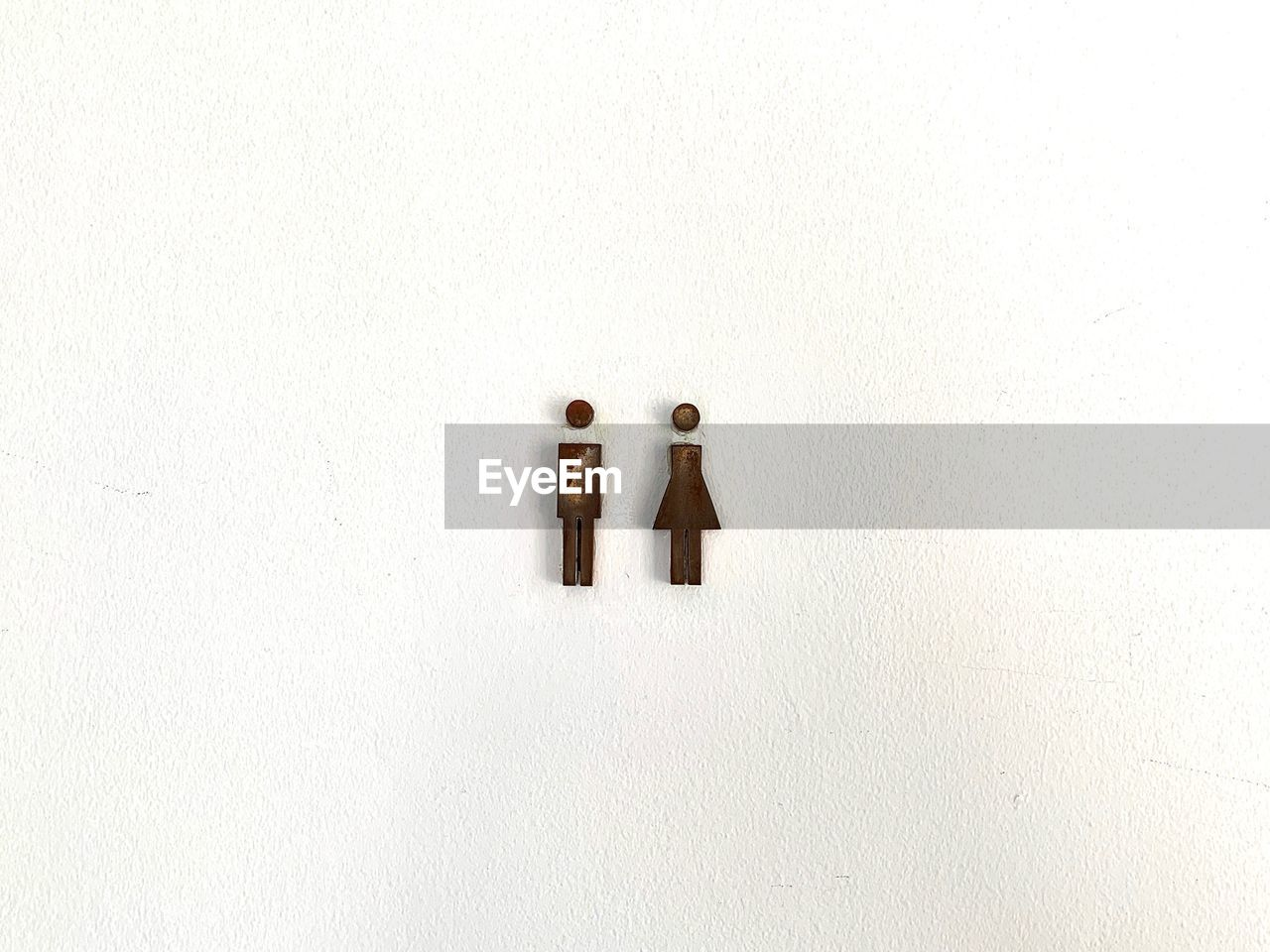no people, copy space, wall - building feature, creativity, human representation, white color, indoors, representation, art and craft, still life, built structure, white background, day, architecture, white, wall, close-up, female likeness, side by side, anthropomorphic