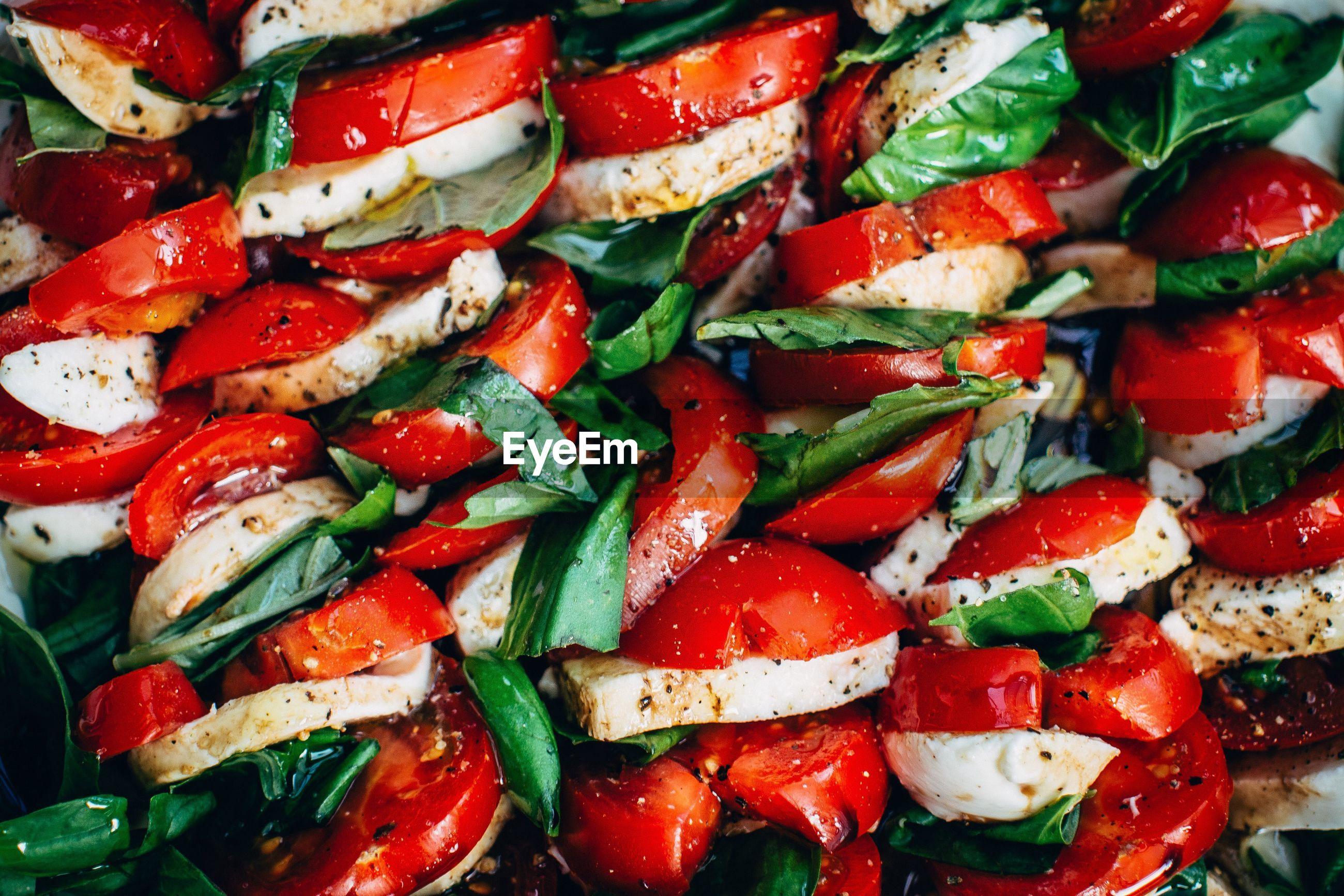 Fresh tomatoes staffed with basil and mozzarella