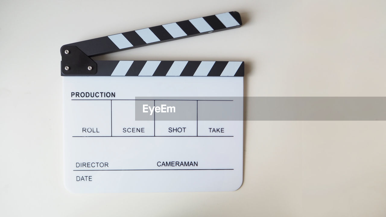 Directly above shot of film slate on table