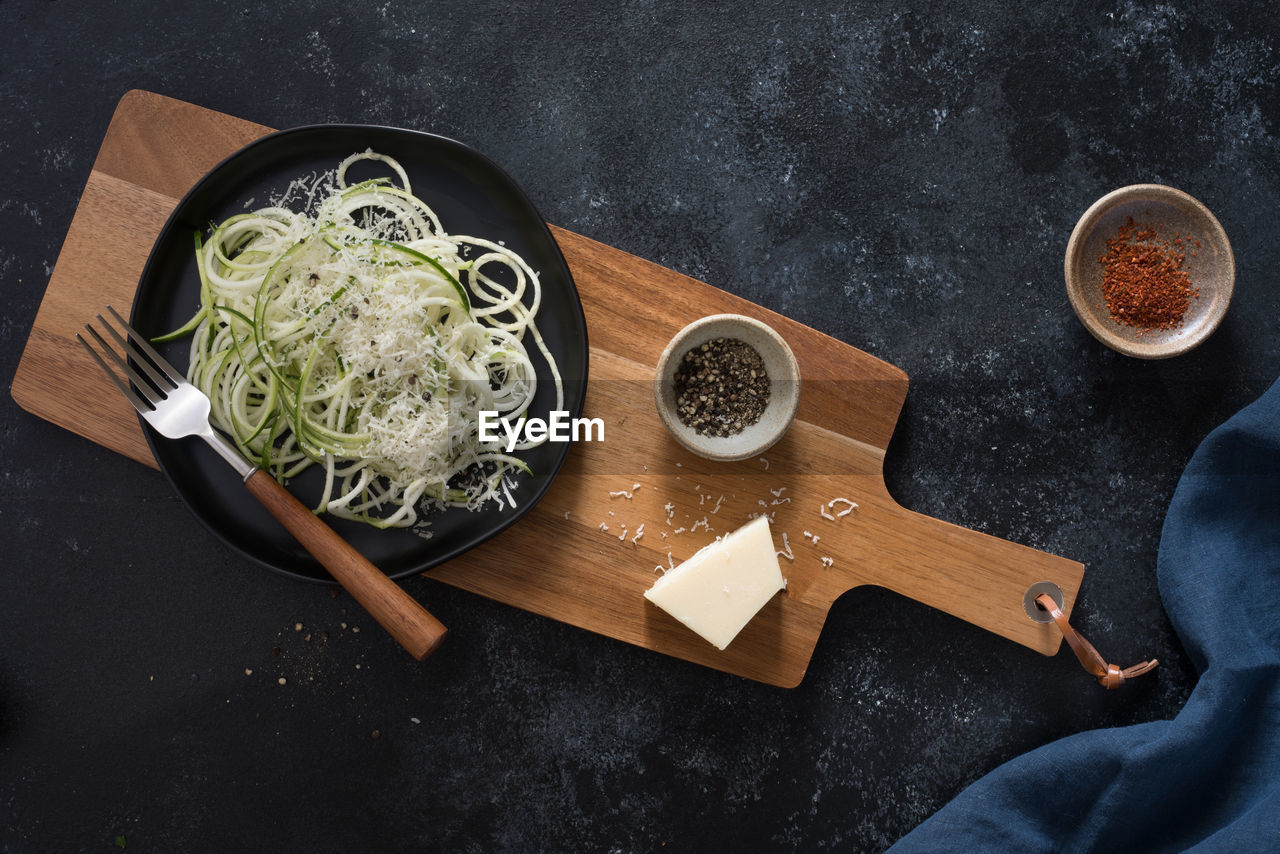 Directly above shot of food on cutting board at table