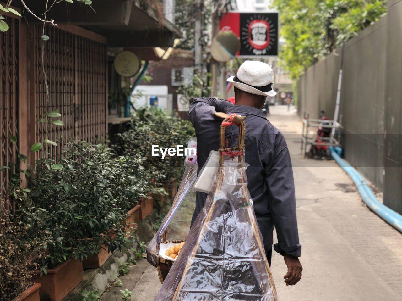 Man Selling Food In City