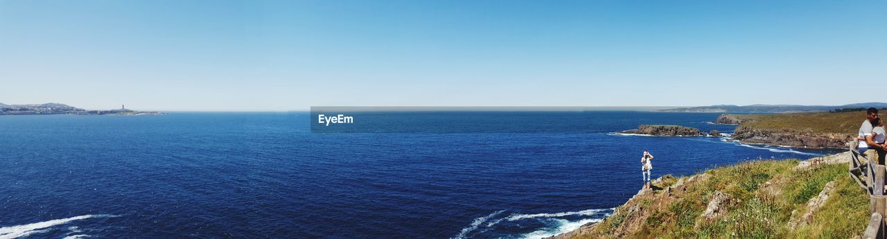 PANORAMIC VIEW OF SEA AGAINST CLEAR SKY