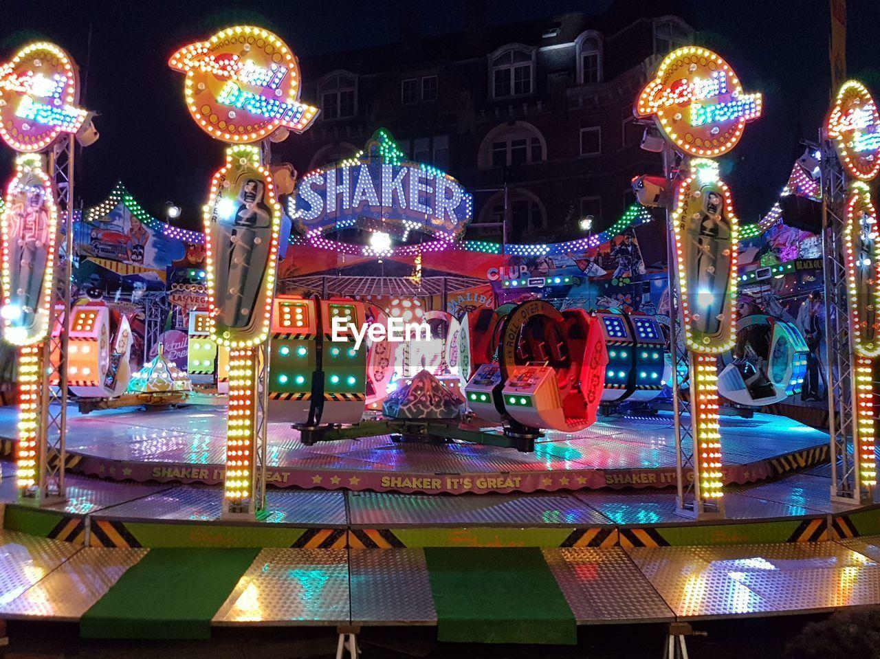 amusement park, illuminated, night, arts culture and entertainment, multi colored, amusement park ride, carousel, outdoors, no people, enjoyment, ride, christmas market, sky