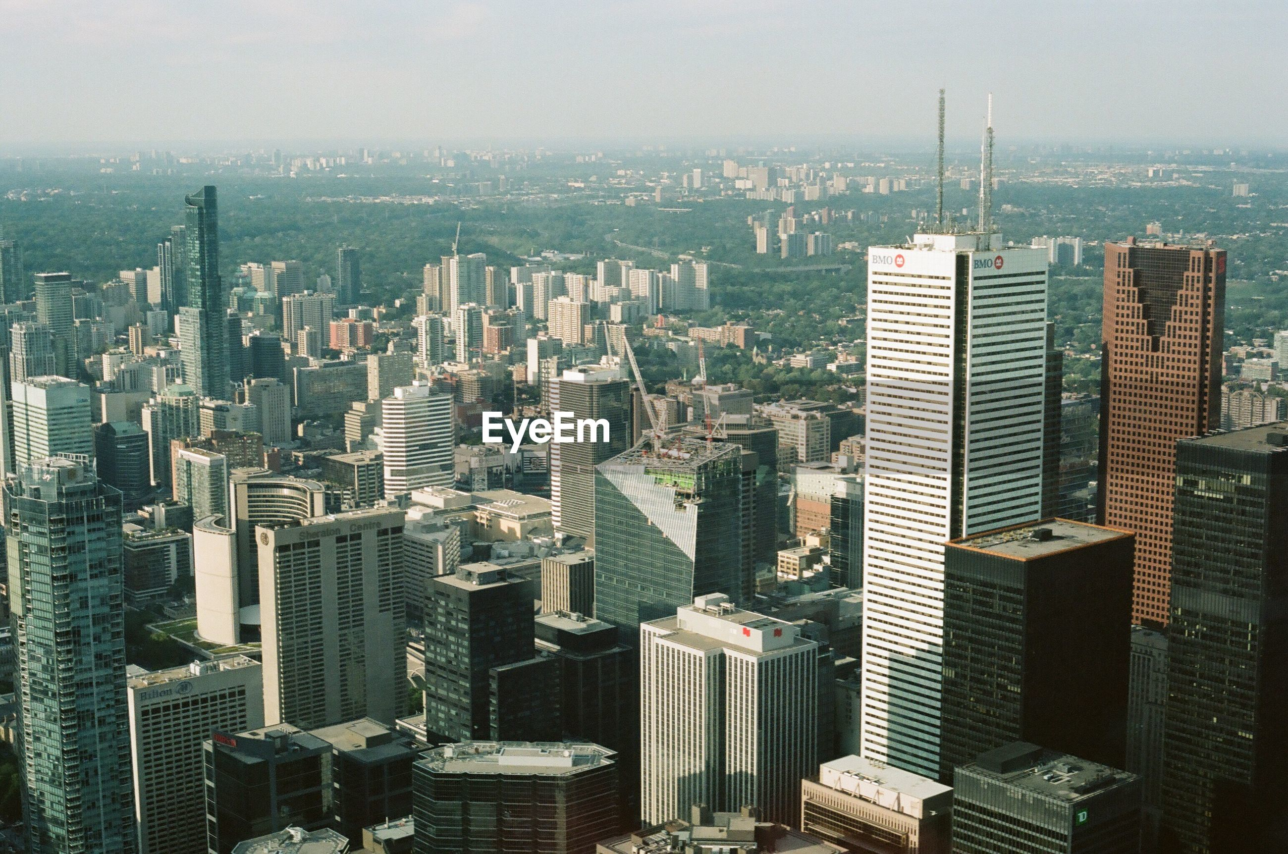 AERIAL VIEW OF CITYSCAPE AGAINST SKY