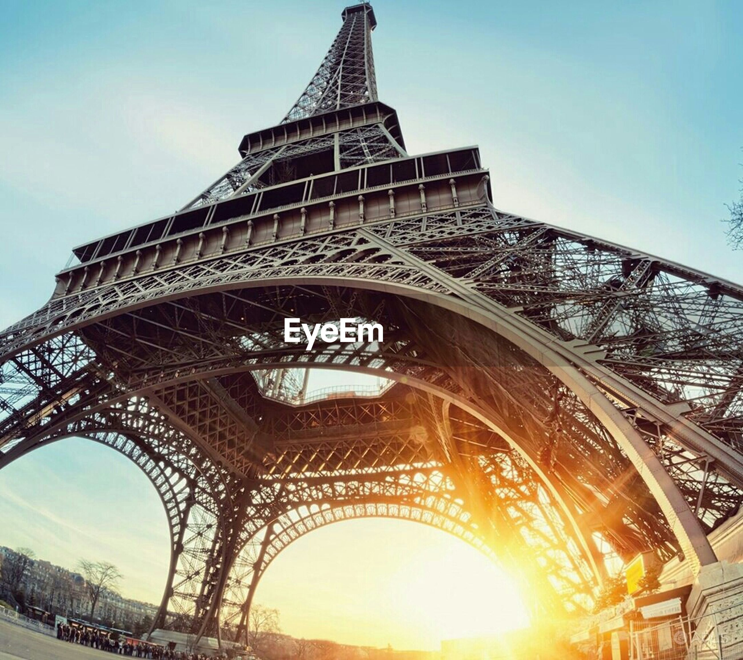 architecture, built structure, famous place, international landmark, travel destinations, tourism, capital cities, eiffel tower, travel, low angle view, tower, culture, building exterior, metal, engineering, city, bridge - man made structure, sky, tall - high, history