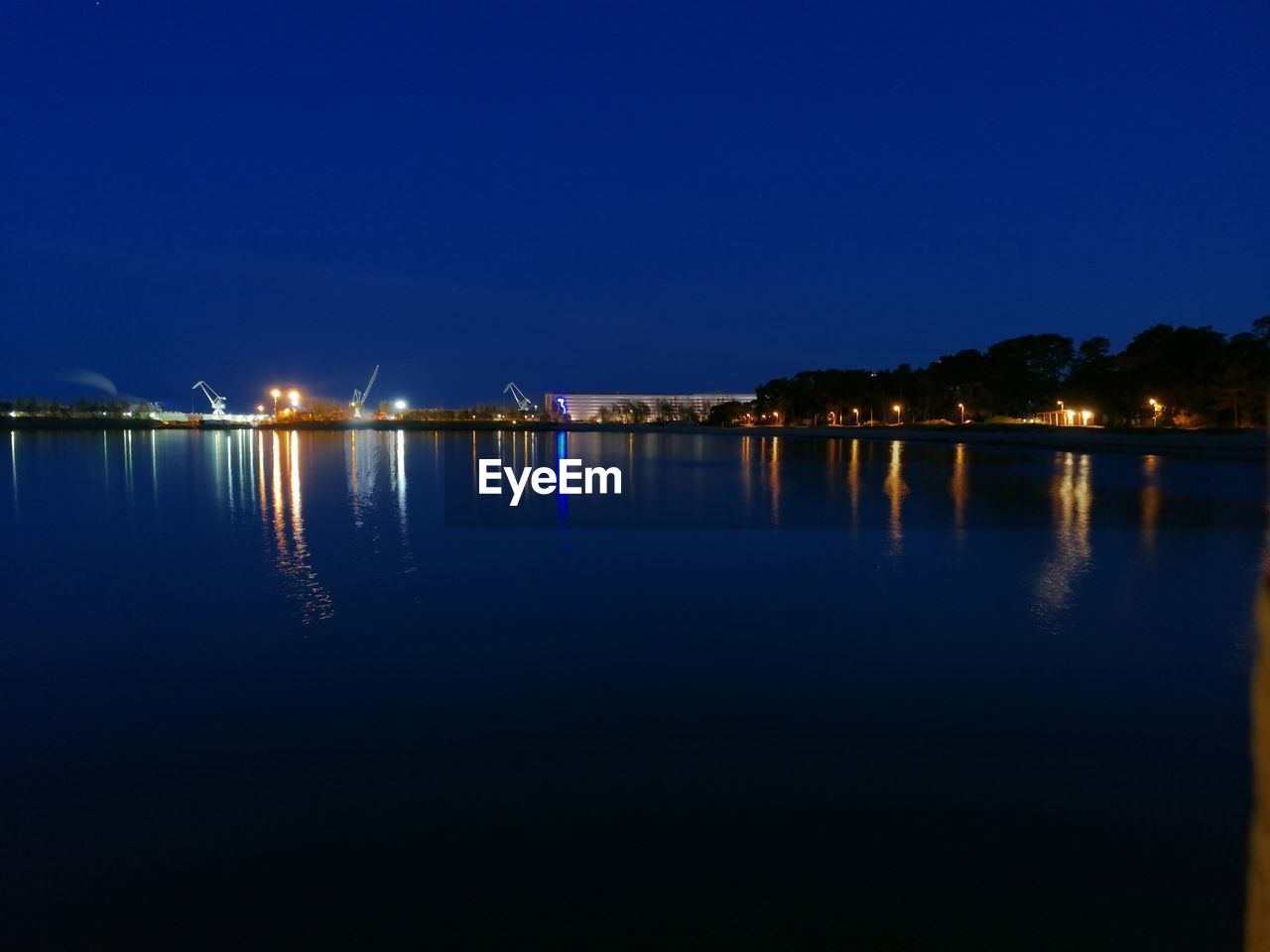 water, reflection, illuminated, sky, night, waterfront, nature, no people, copy space, tranquility, scenics - nature, clear sky, blue, beauty in nature, outdoors, tranquil scene, architecture, lake