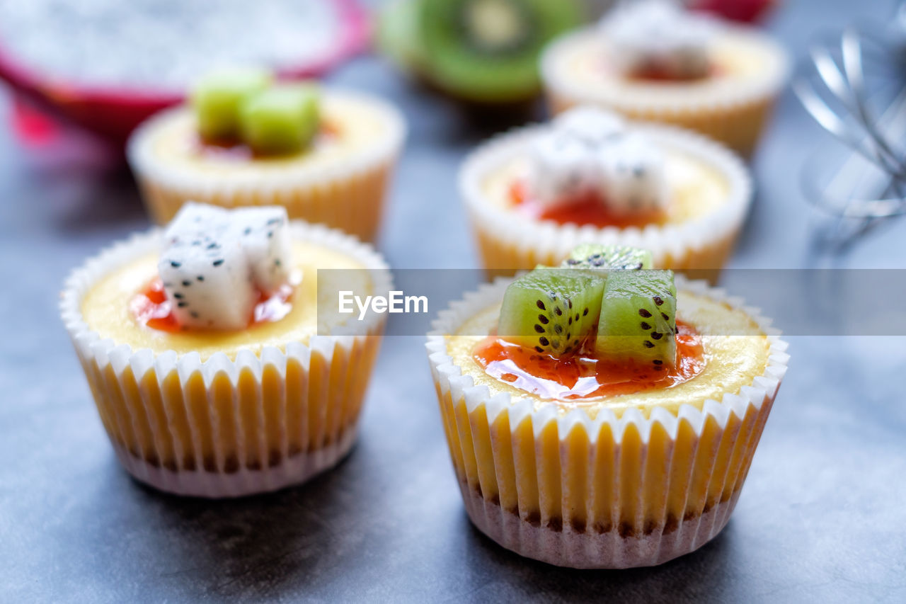 sweet food, dessert, food and drink, cupcake, sweet, food, cake, temptation, ready-to-eat, indulgence, freshness, still life, selective focus, baked, indoors, no people, close-up, unhealthy eating, table, focus on foreground, cupcake holder, baked pastry item, snack