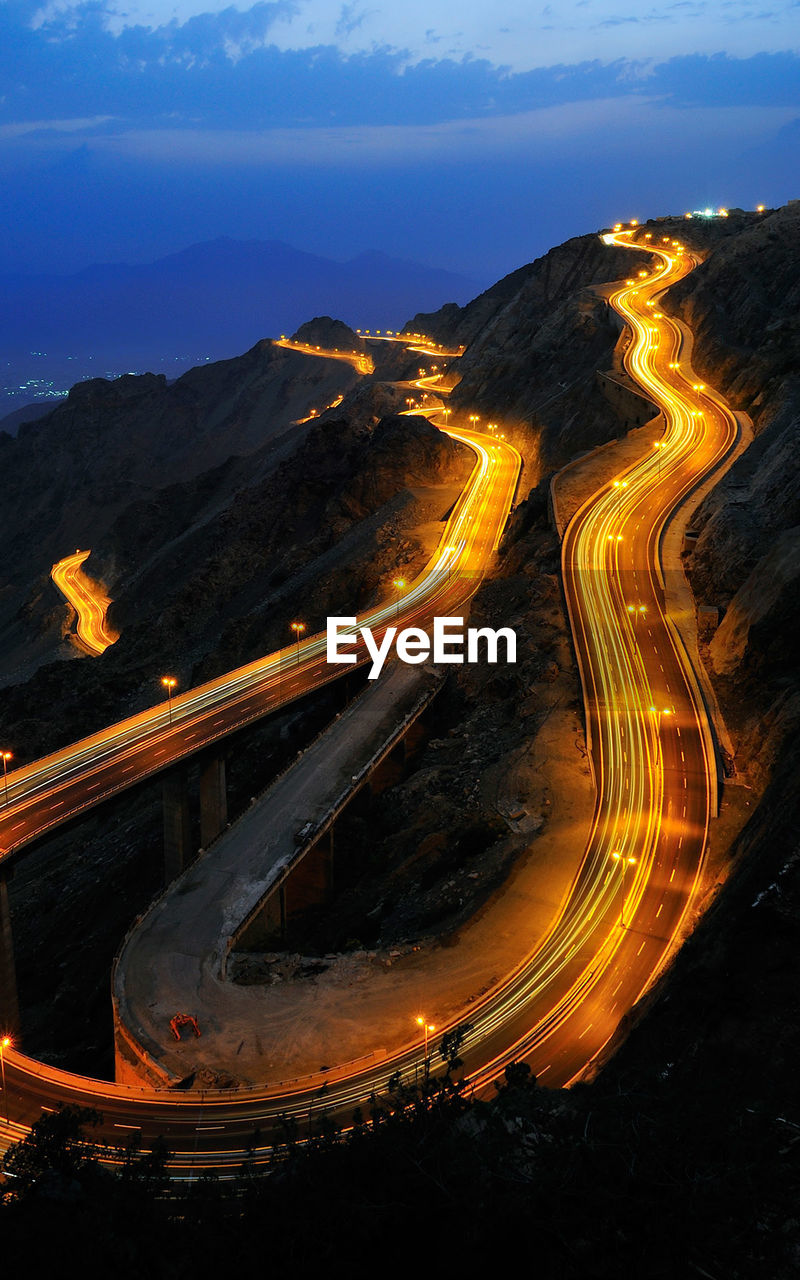 High Angle View Of Curved Illuminated Road