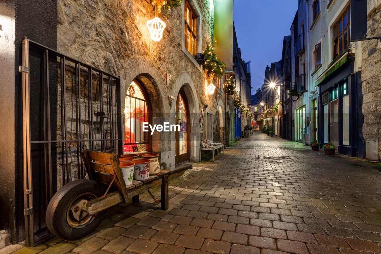 architecture, cobblestone, building exterior, street, built structure, no people, outdoors, illuminated, day, city