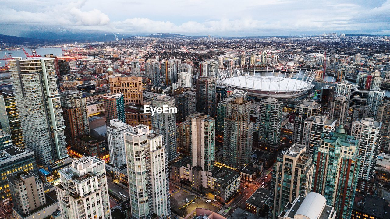 cityscape, architecture, skyscraper, city, crowded, building exterior, sky, aerial view, downtown, built structure, modern, travel destinations, outdoors, day
