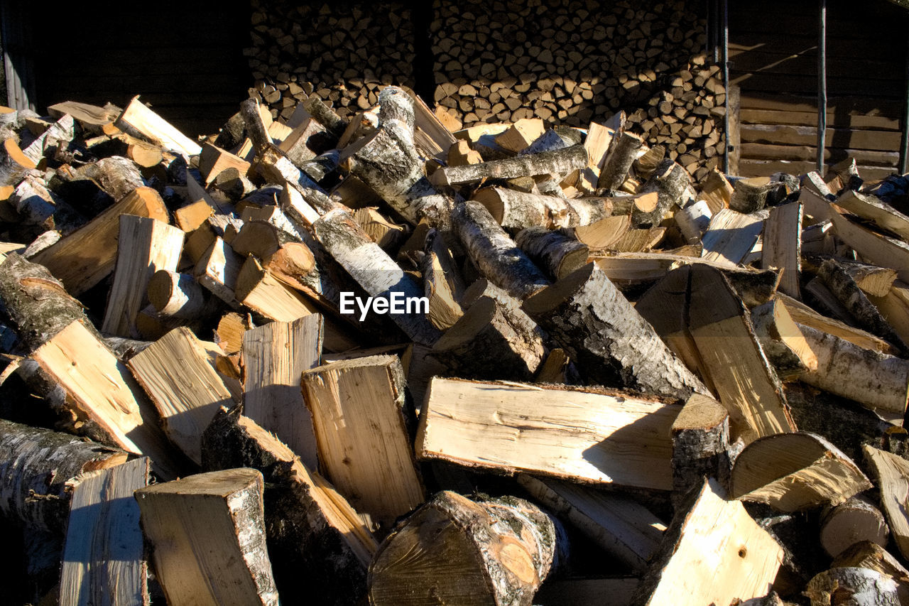 large group of objects, log, stack, wood, timber, wood - material, abundance, heap, no people, industry, firewood, nature, lumber industry, tree, backgrounds, deforestation, day, construction industry, outdoors, environmental issues, chaos, breaking