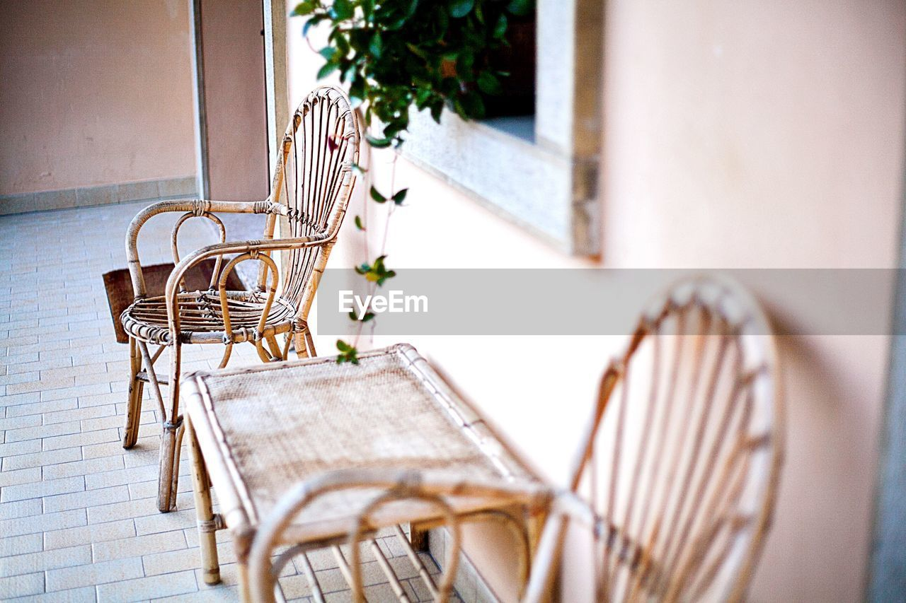 Empty Chairs In Balcony Of House