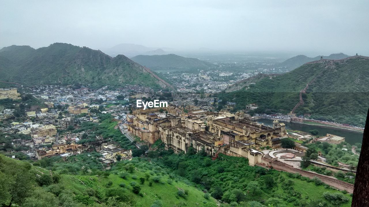 High angle view of buildings amidst mountains