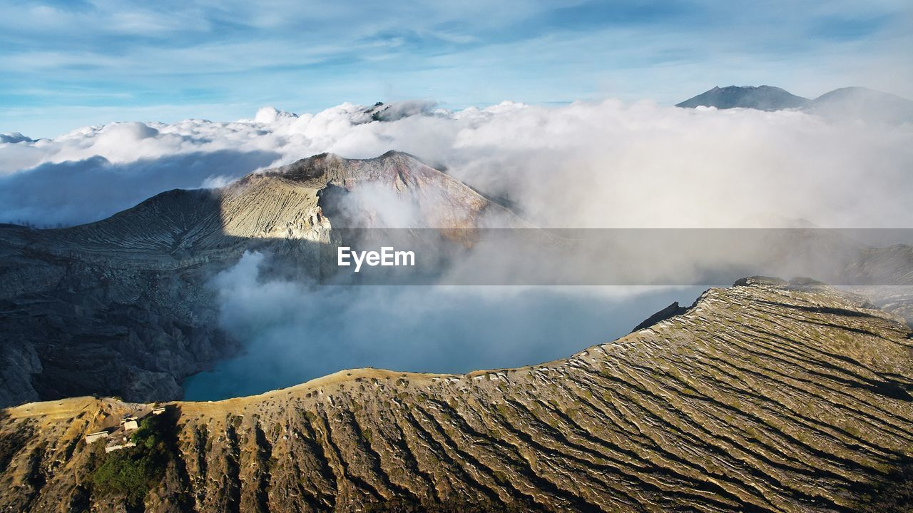 View of smoke emitting from volcanic mountain