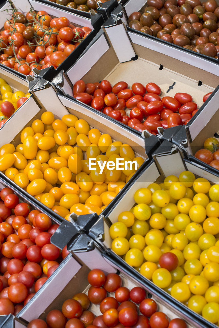 fruit, healthy eating, food, food and drink, tomato, wellbeing, large group of objects, kitchen utensil, vegetable, container, olive, eating utensil, red, no people, freshness, orange color, cherry tomato, retail, abundance, yellow