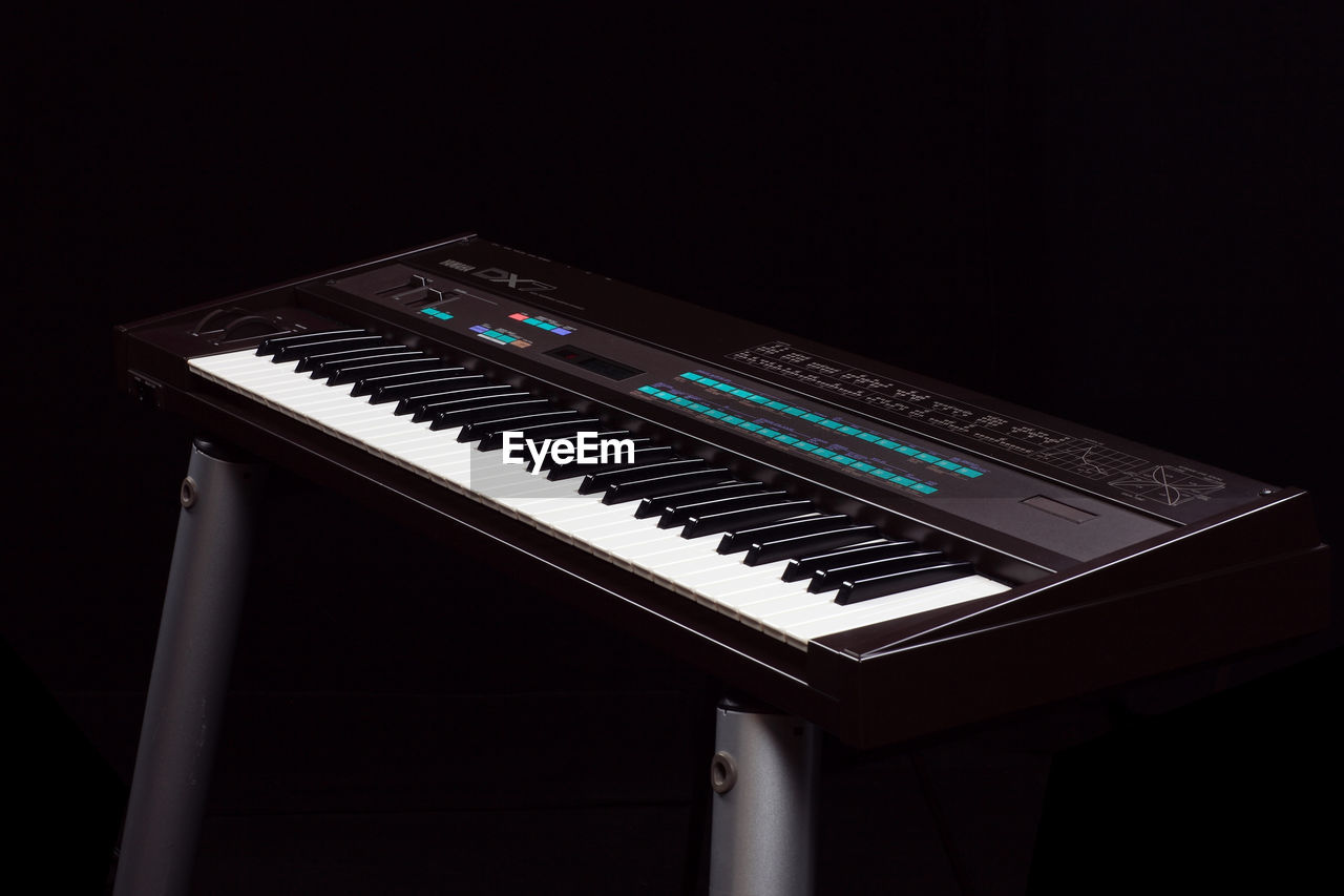music, musical instrument, no people, arts culture and entertainment, black background, piano key, indoors, close-up, keyboard, day