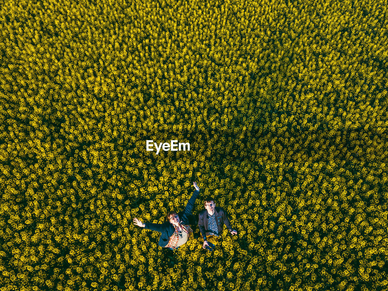 Aerial View Of People Standing On Field