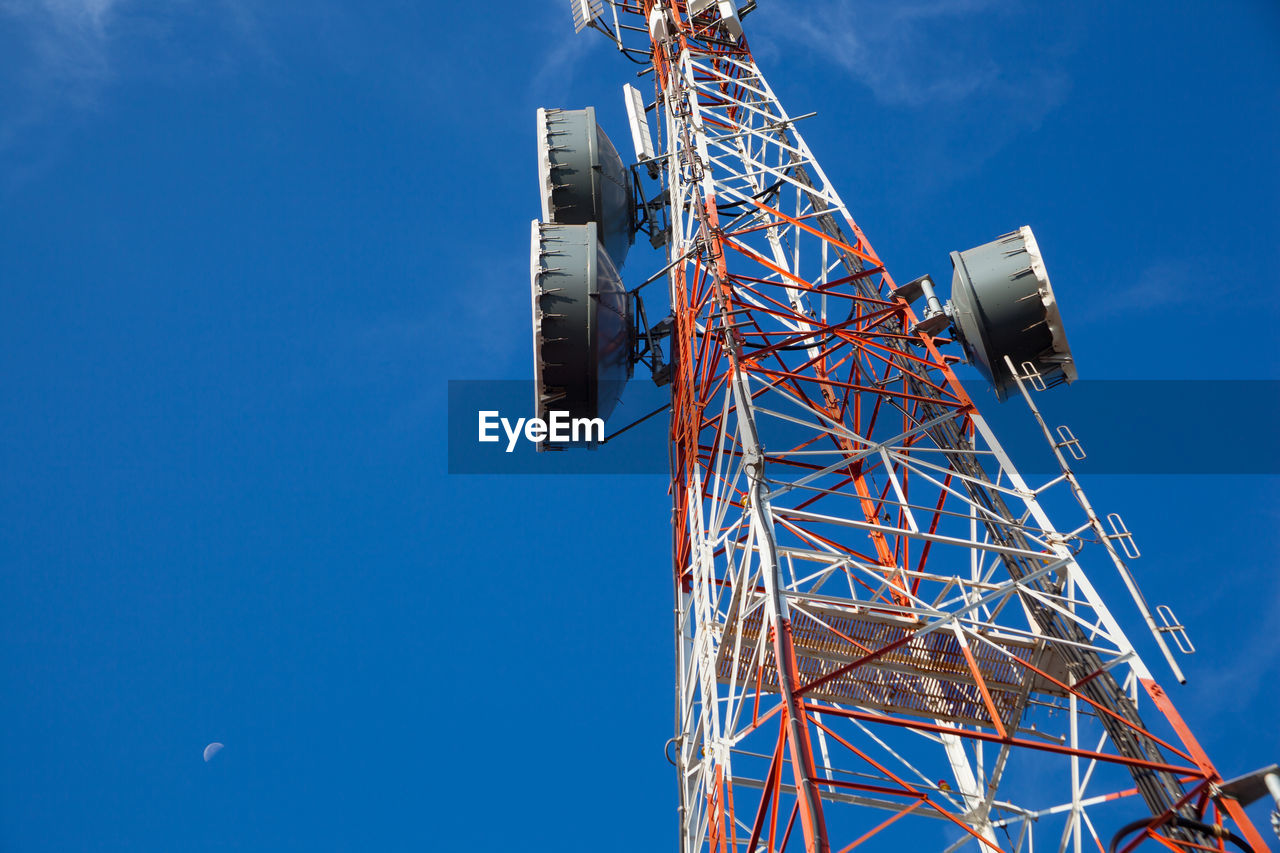 sky, low angle view, communication, blue, architecture, built structure, global communications, nature, satellite, tower, technology, connection, satellite dish, broadcasting, no people, tall - high, telecommunications equipment, metal, clear sky, outdoors, radio wave, receiving