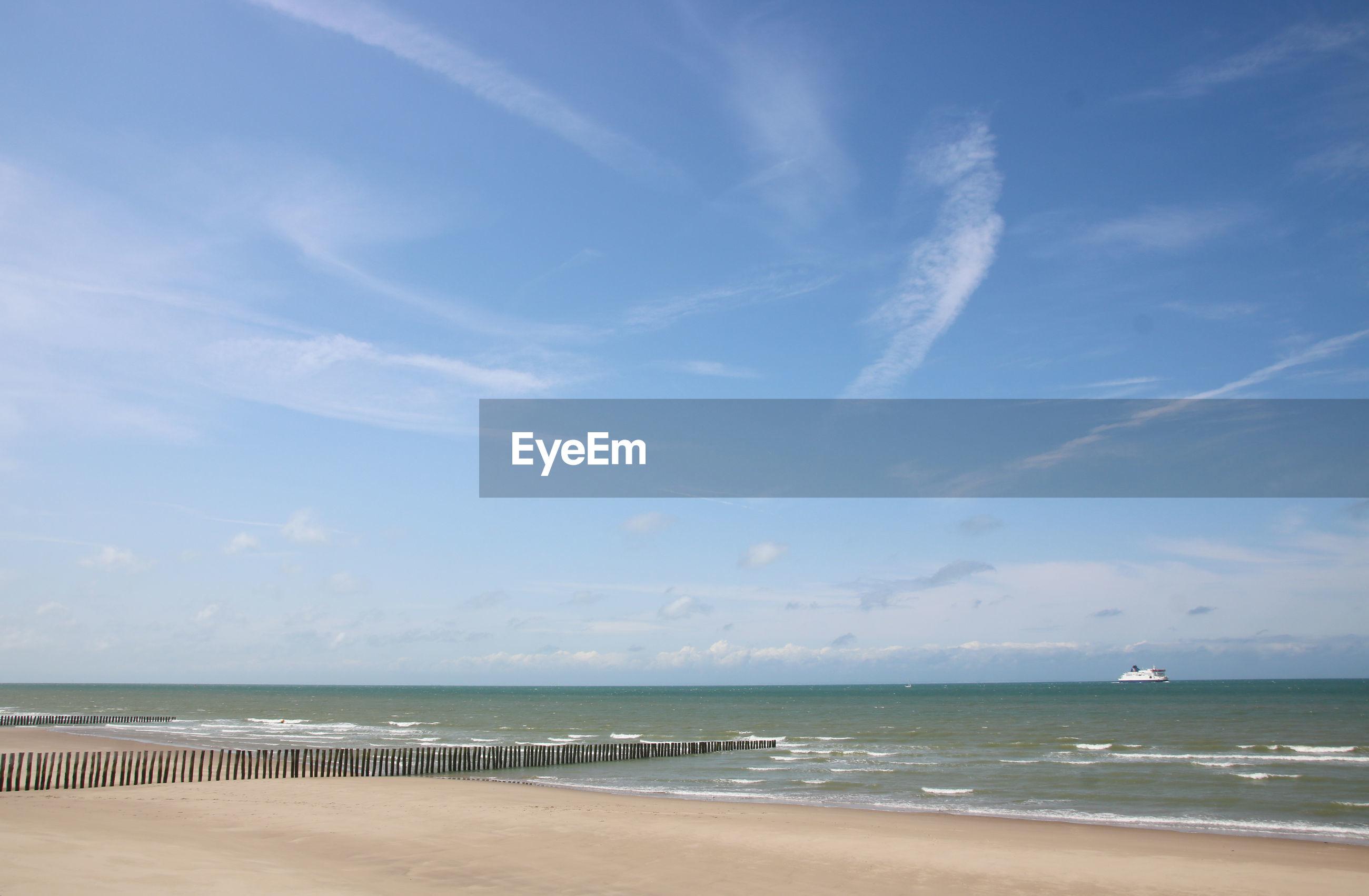 PANORAMIC VIEW OF BEACH AGAINST SKY