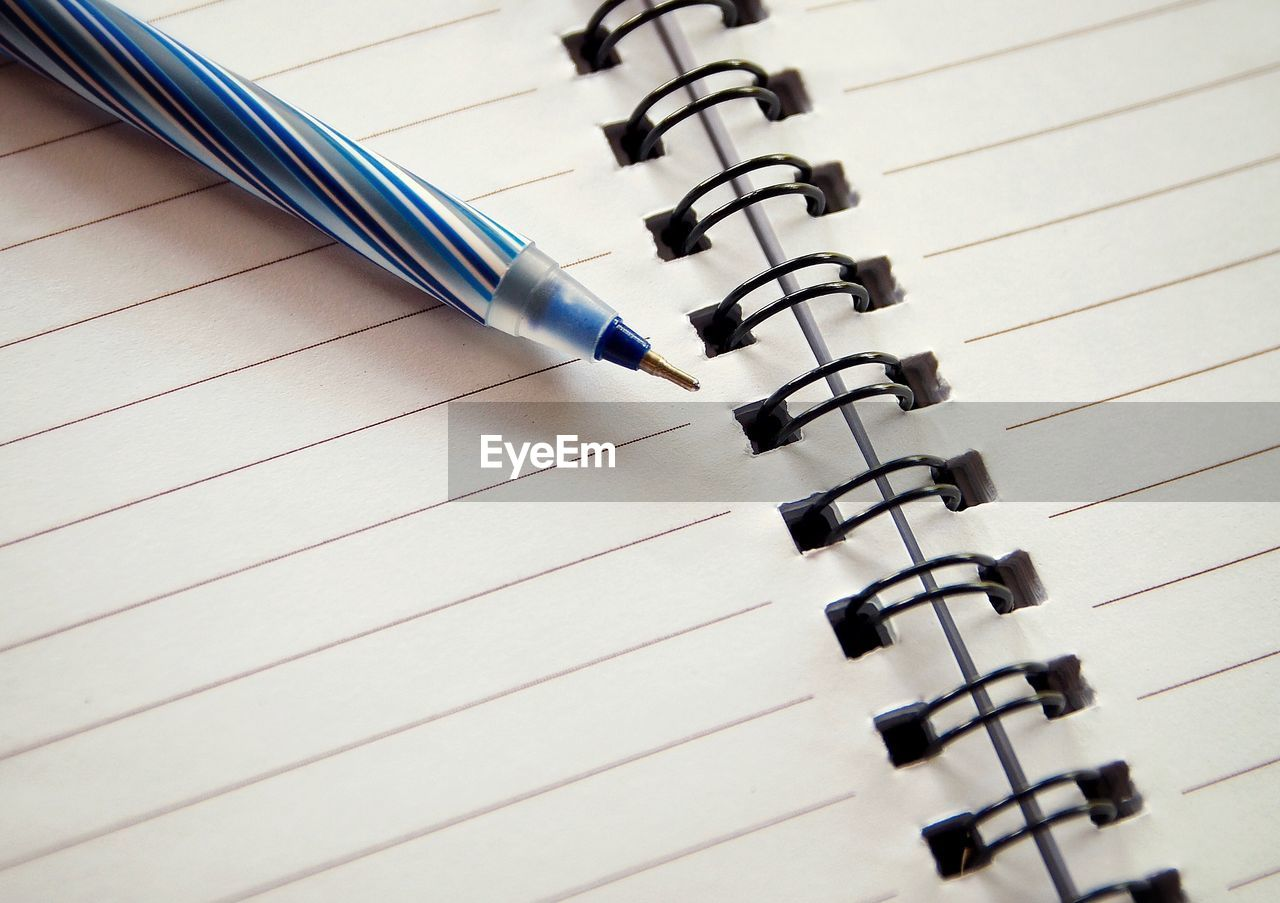 HIGH ANGLE VIEW OF PEN AND PAPER