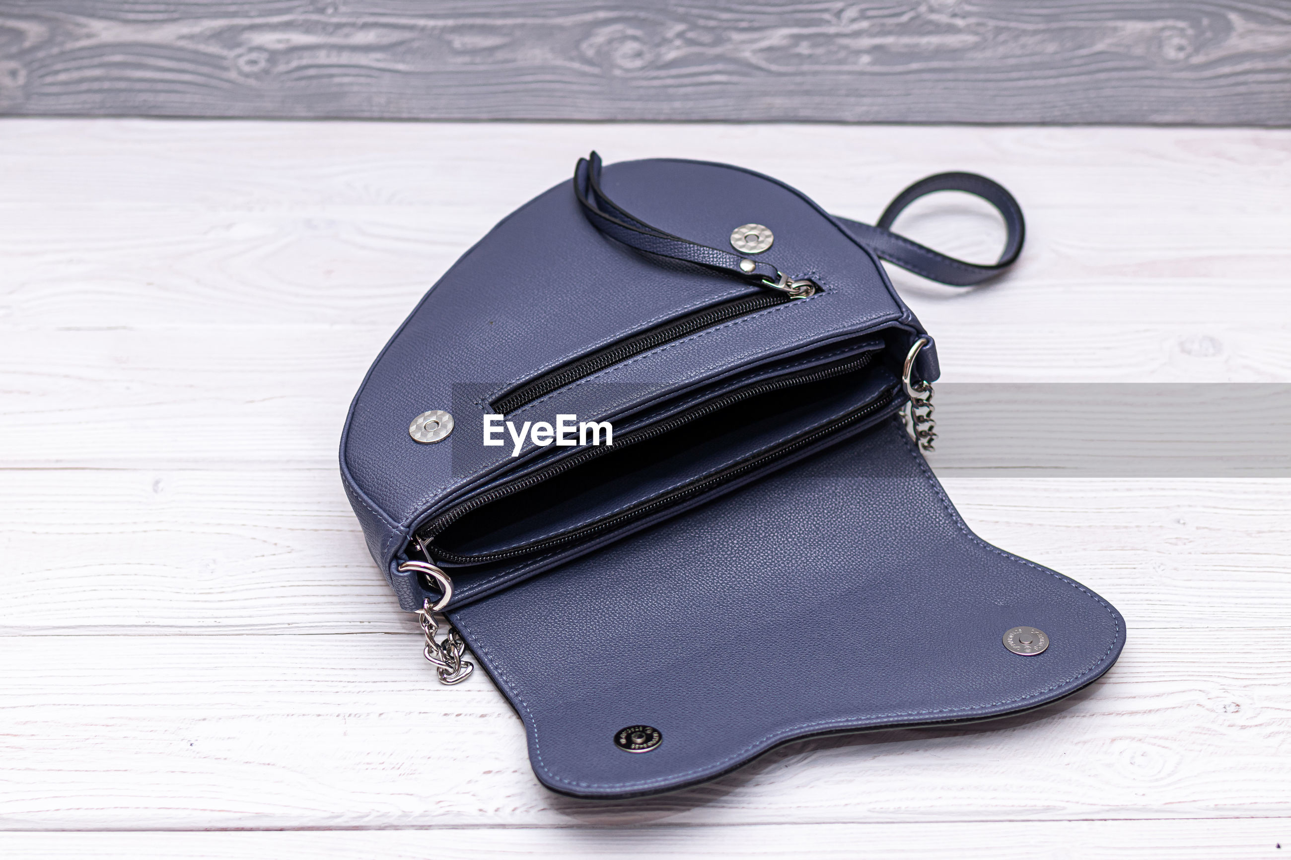 High angle view of blue purse on table