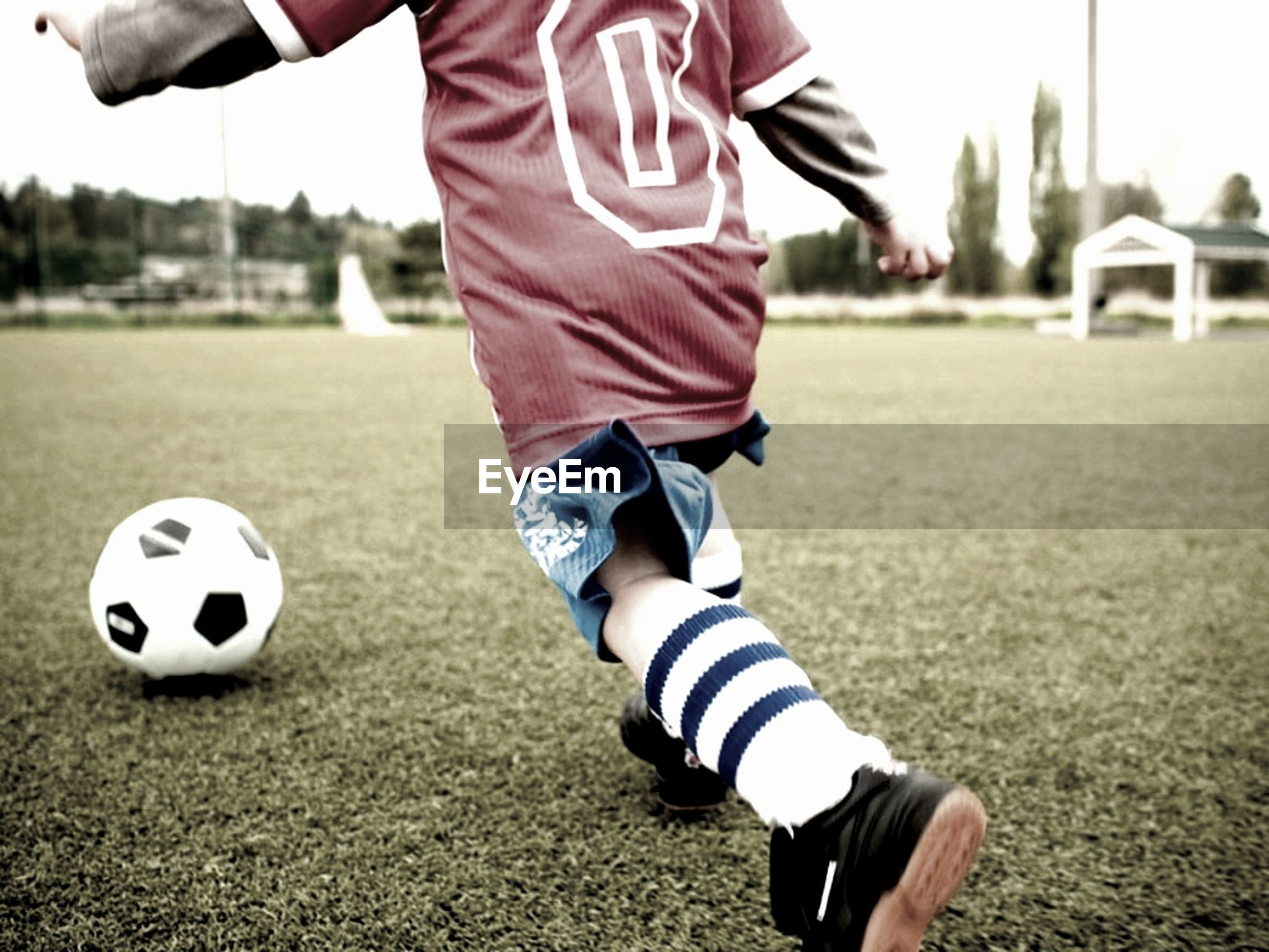 lifestyles, focus on foreground, leisure activity, childhood, low section, sport, casual clothing, day, outdoors, standing, grass, holding, playing, field, boys, close-up, sand