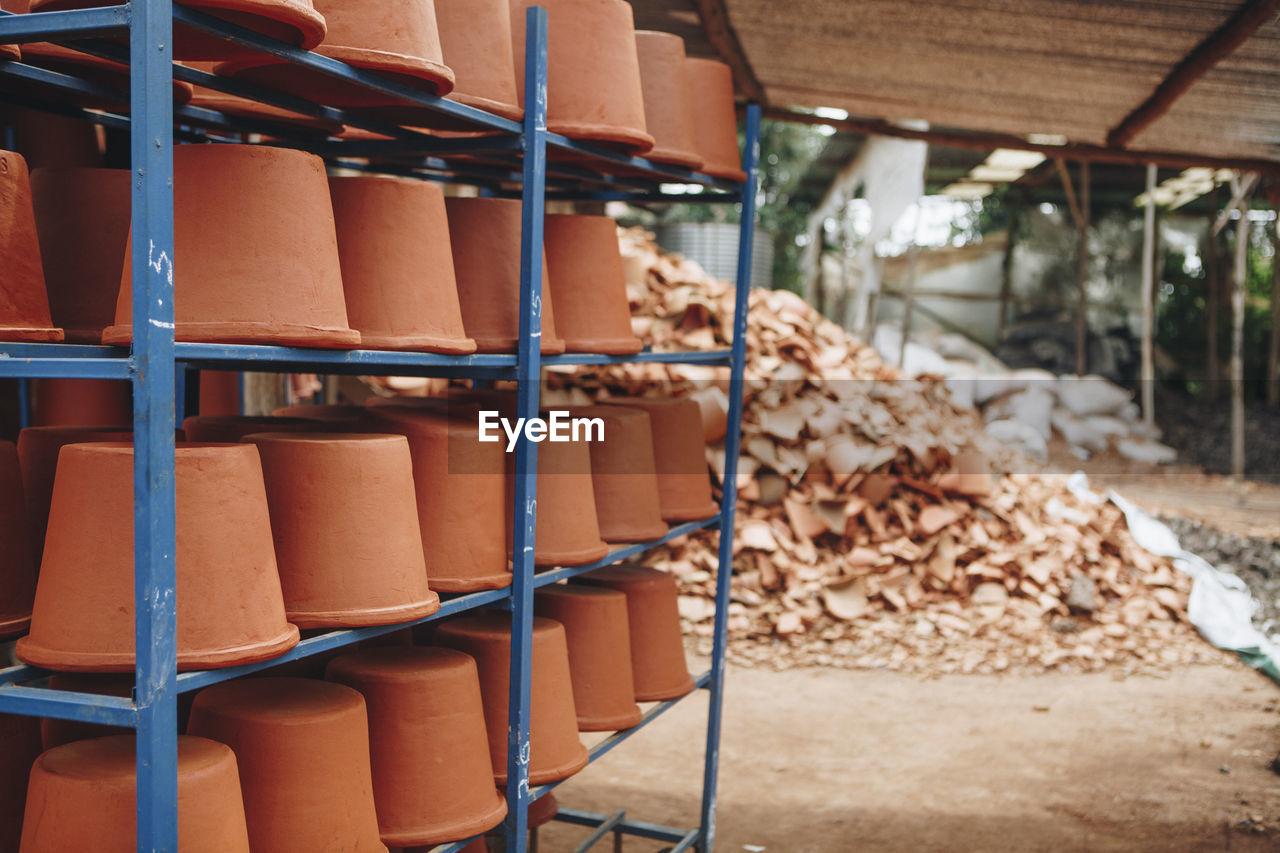 Clay Pots On Shelves At Warehouse