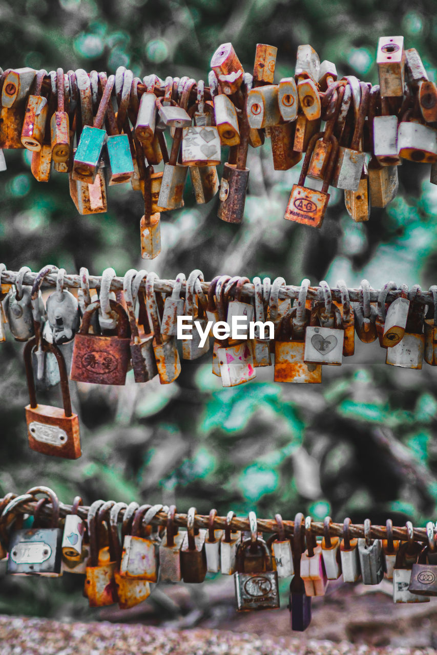 large group of objects, padlock, lock, love, hanging, love lock, positive emotion, hope - concept, luck, safety, day, close-up, protection, no people, security, metal, focus on foreground, abundance, emotion, railing, outdoors