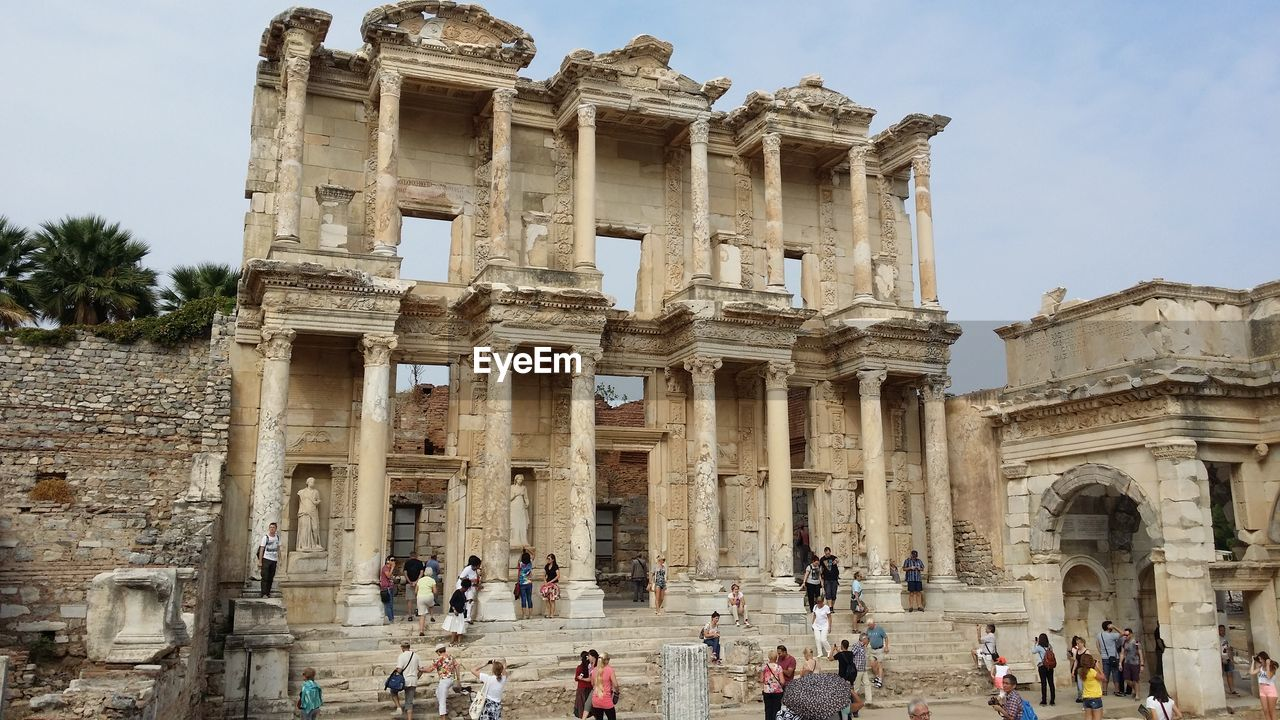 group of people, large group of people, crowd, built structure, architecture, history, tourism, the past, real people, travel, travel destinations, building exterior, ancient, men, sky, tourist, old ruin, day, nature, ancient civilization, architectural column, outdoors, archaeology, ruined