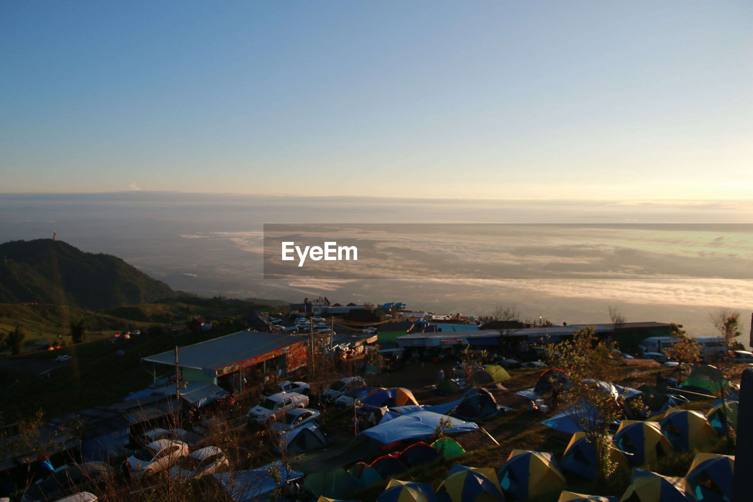 High angle view of tents in town against sky during sunset