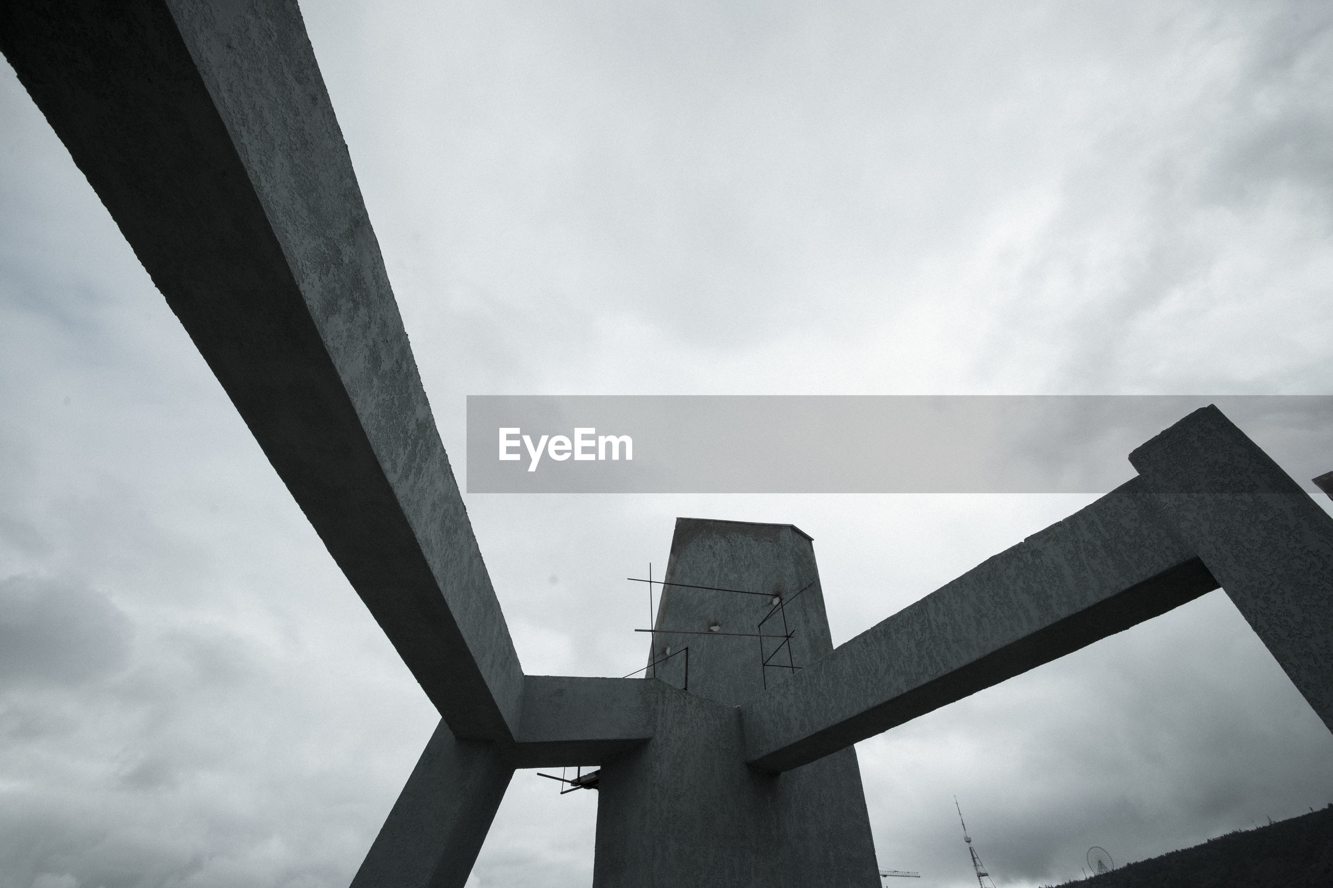 LOW ANGLE VIEW OF CROSS BRIDGE AGAINST SKY
