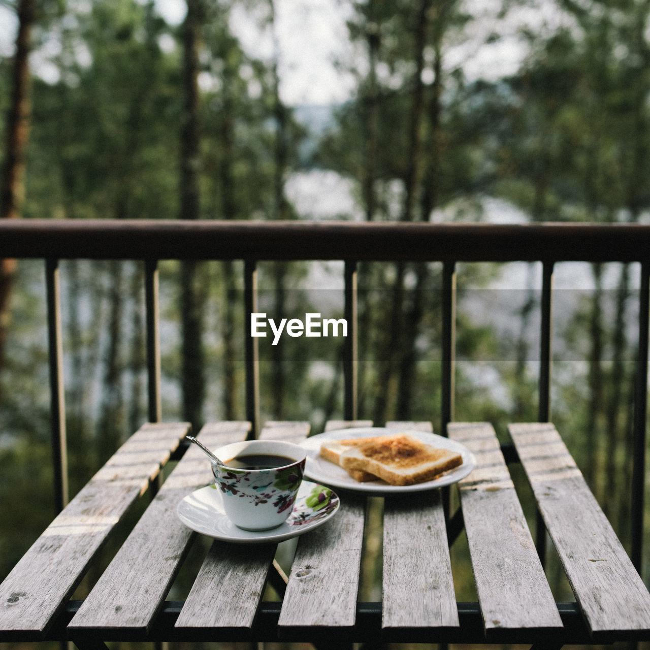Breakfast On Table Against Balcony