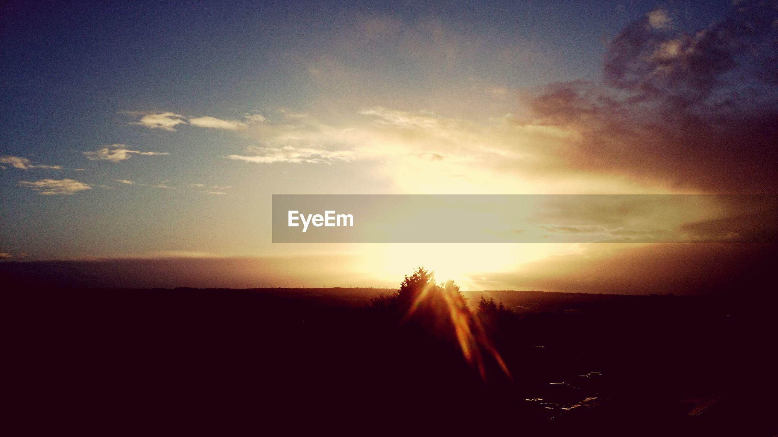 sun, sunset, sky, sunbeam, scenics, tranquil scene, silhouette, beauty in nature, sunlight, tranquility, cloud - sky, nature, lens flare, idyllic, landscape, cloud, orange color, back lit, outdoors, no people