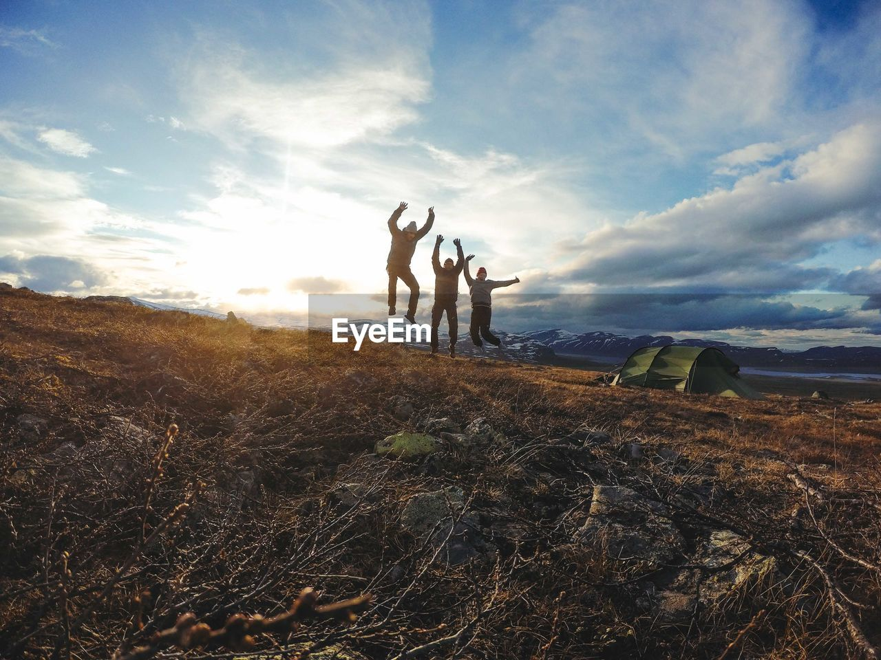 sky, cloud - sky, land, group of people, real people, field, nature, beauty in nature, leisure activity, scenics - nature, togetherness, lifestyles, men, non-urban scene, adult, grass, landscape, environment, tranquility, women, human arm, outdoors, arms raised