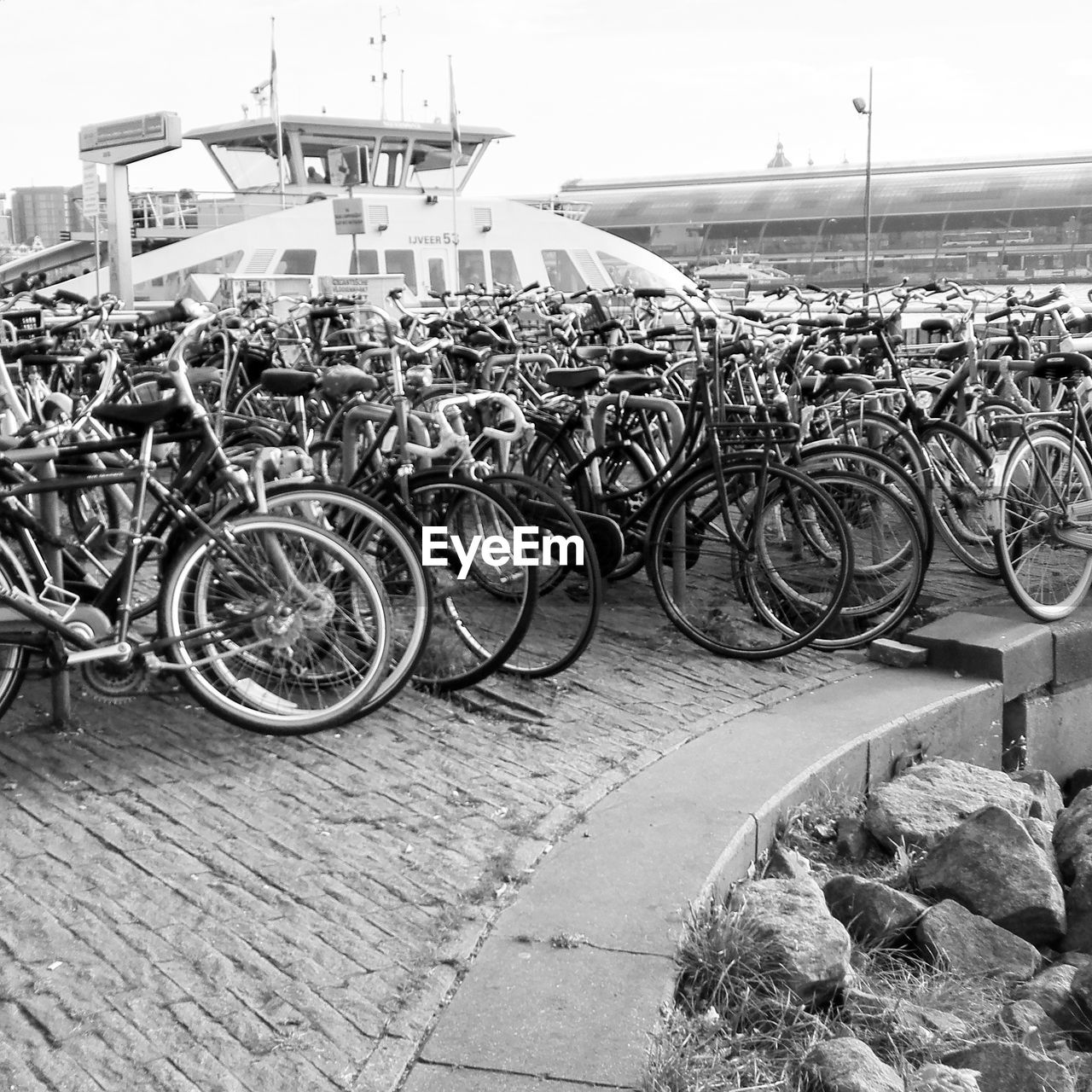 bicycle, mode of transport, transportation, stationary, land vehicle, outdoors, day, bicycle rack, no people, large group of objects, sky