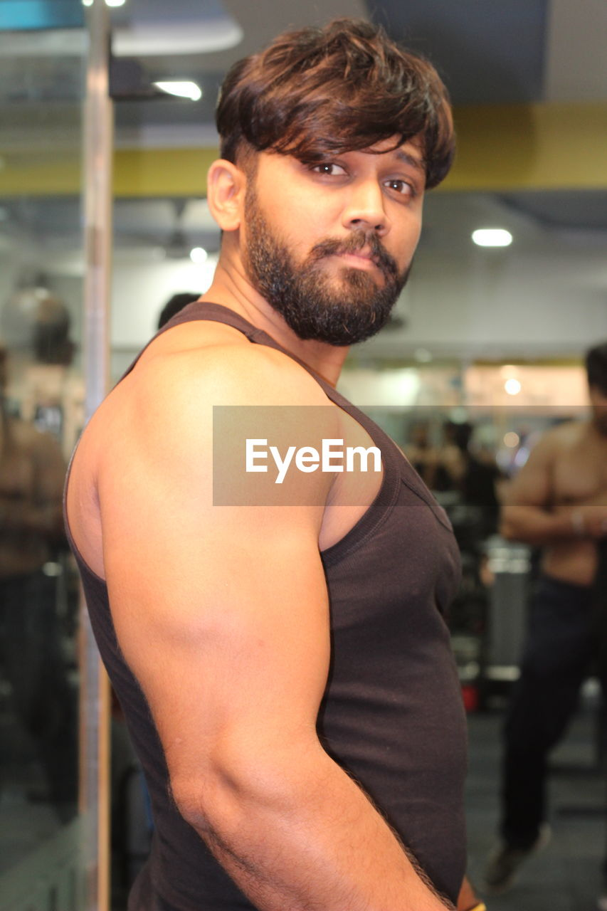 beard, young men, young adult, men, one person, lifestyles, real people, indoors, strength, portrait, standing, one young man only, gym, muscular build, one man only, adult, people