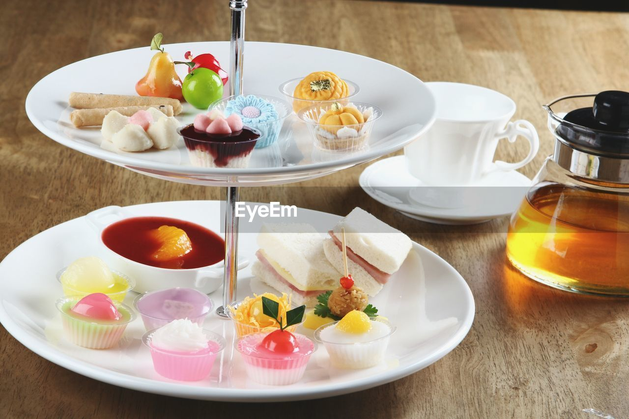 food and drink, food, table, freshness, plate, ready-to-eat, healthy eating, bowl, still life, serving size, sweet food, no people, high angle view, fruit, wellbeing, choice, meal, sweet, refreshment, drink, breakfast, temptation, glass, crockery