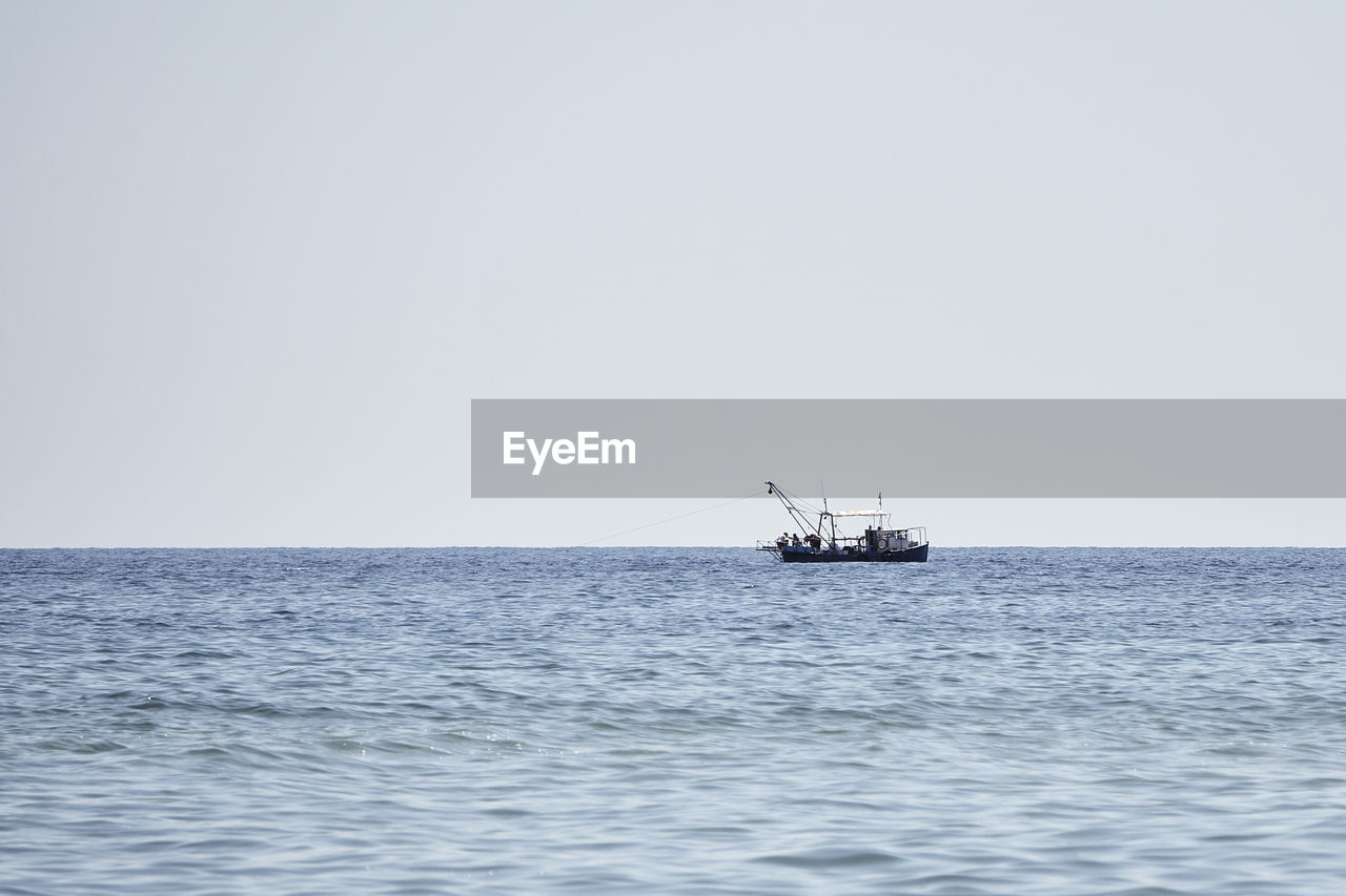 sea, water, horizon, sky, horizon over water, waterfront, copy space, clear sky, beauty in nature, nautical vessel, nature, oil industry, scenics - nature, day, no people, transportation, offshore platform, mode of transportation, industry, outdoors, fishing boat