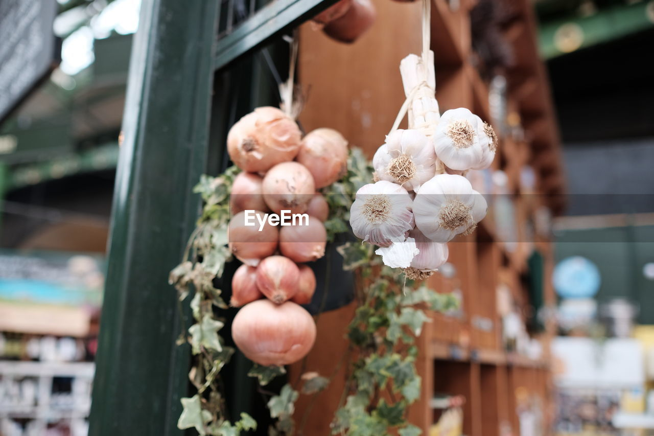 Low angle view of garlic and onions for sale at street market