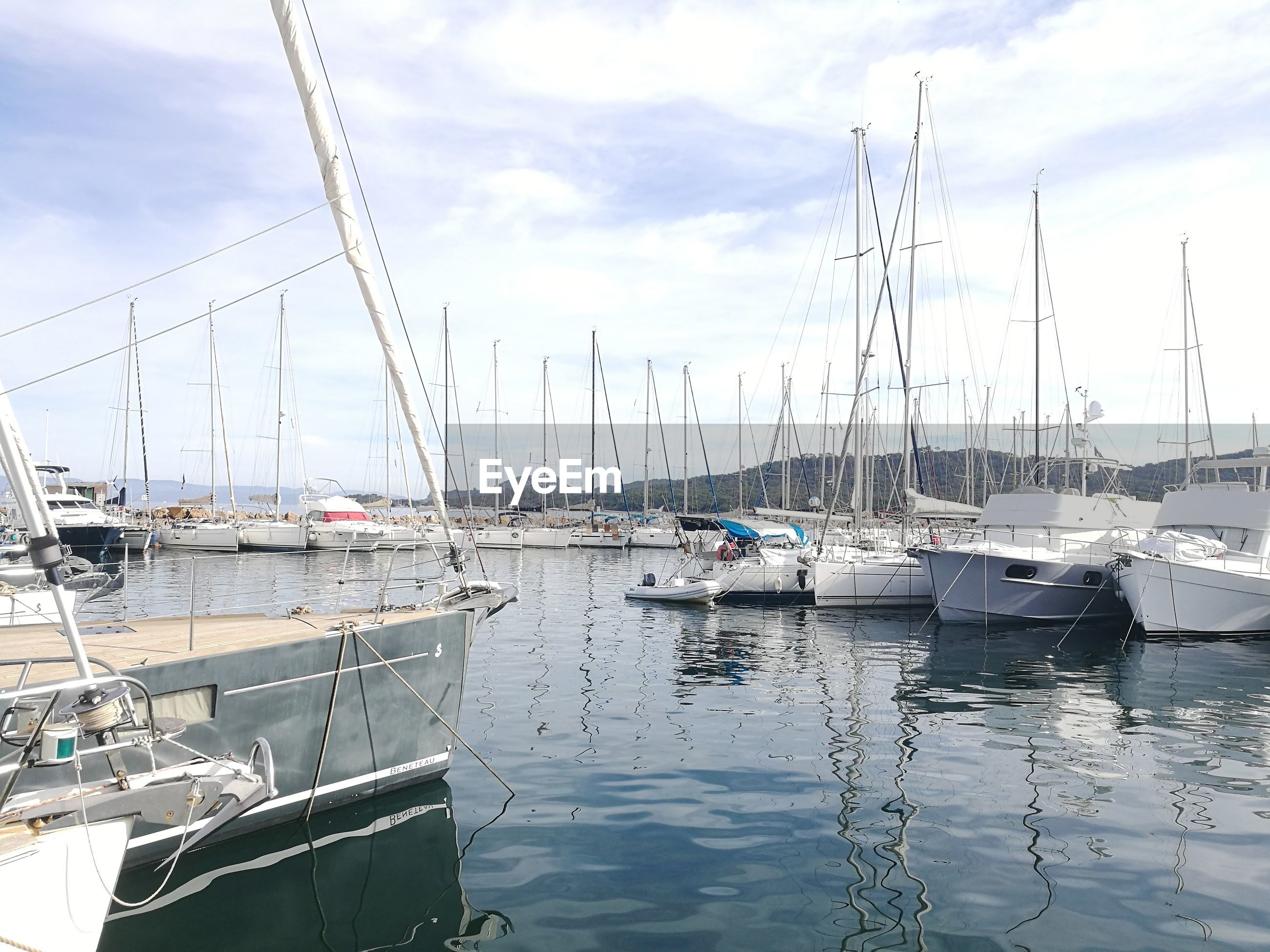 nautical vessel, moored, mode of transport, transportation, boat, water, sky, cloud - sky, no people, outdoors, mast, reflection, day, nature, harbor, sailboat, sea, beauty in nature
