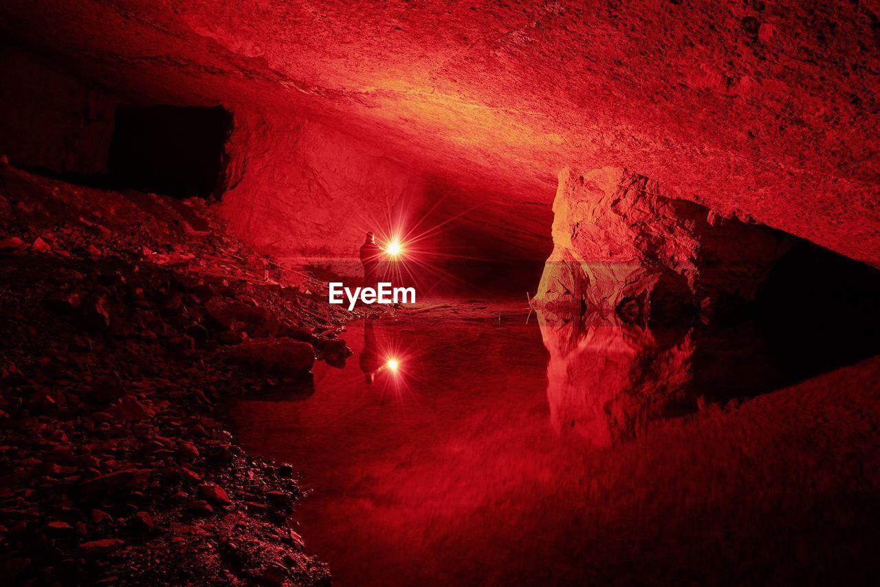 Person In Illuminated Cave
