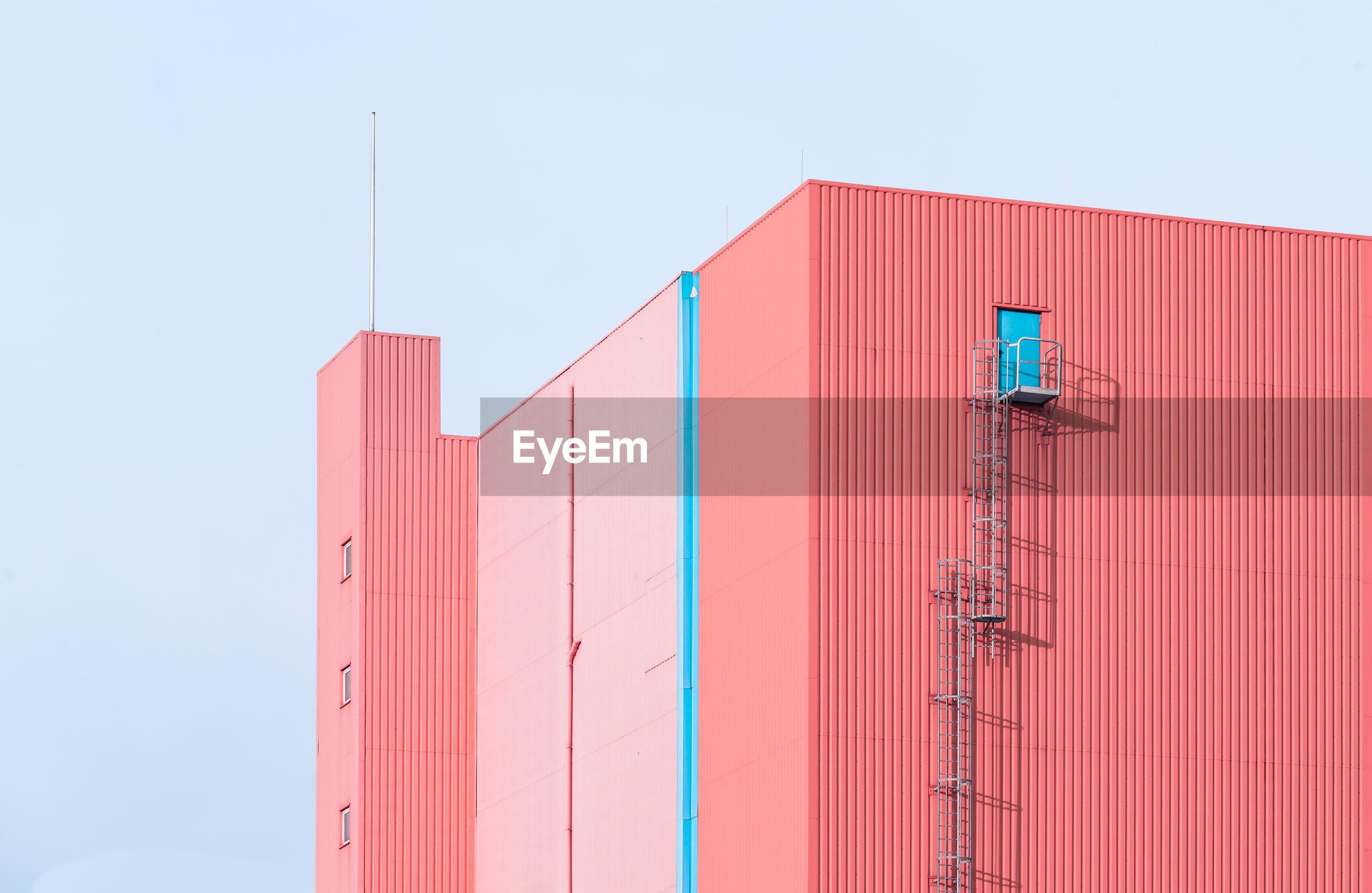 Pink building against sky