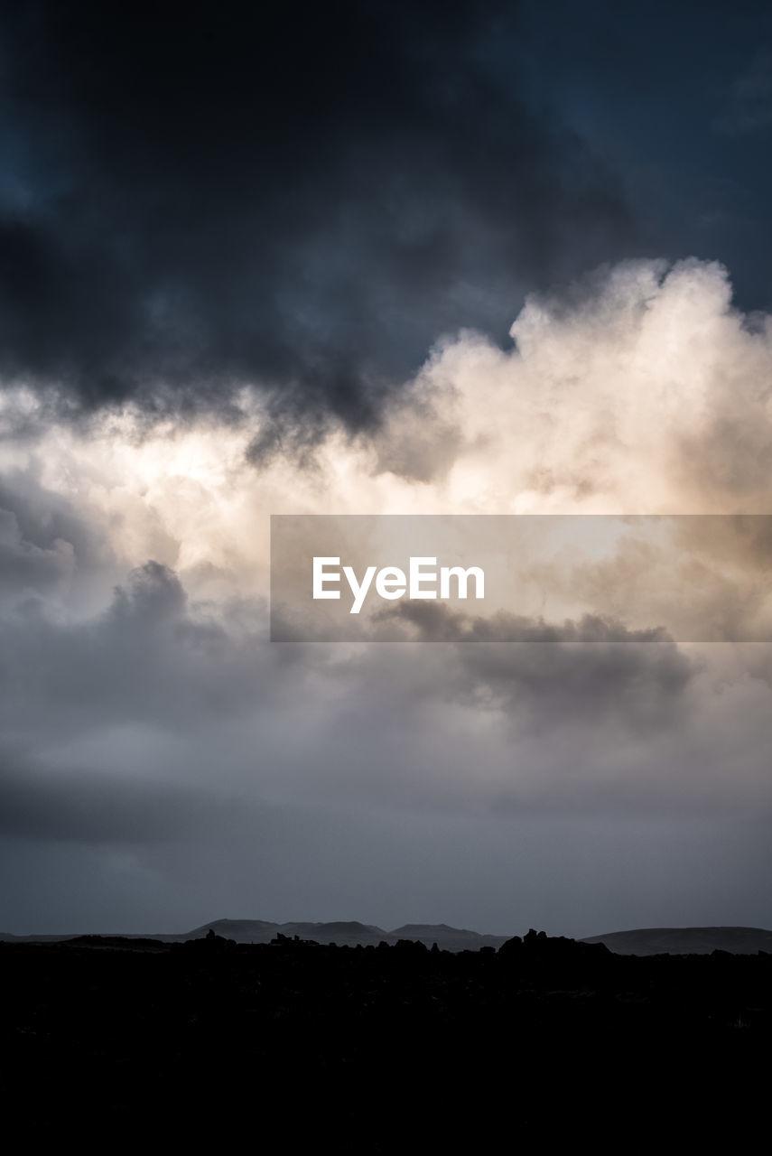 DRAMATIC SKY OVER SILHOUETTE LANDSCAPE