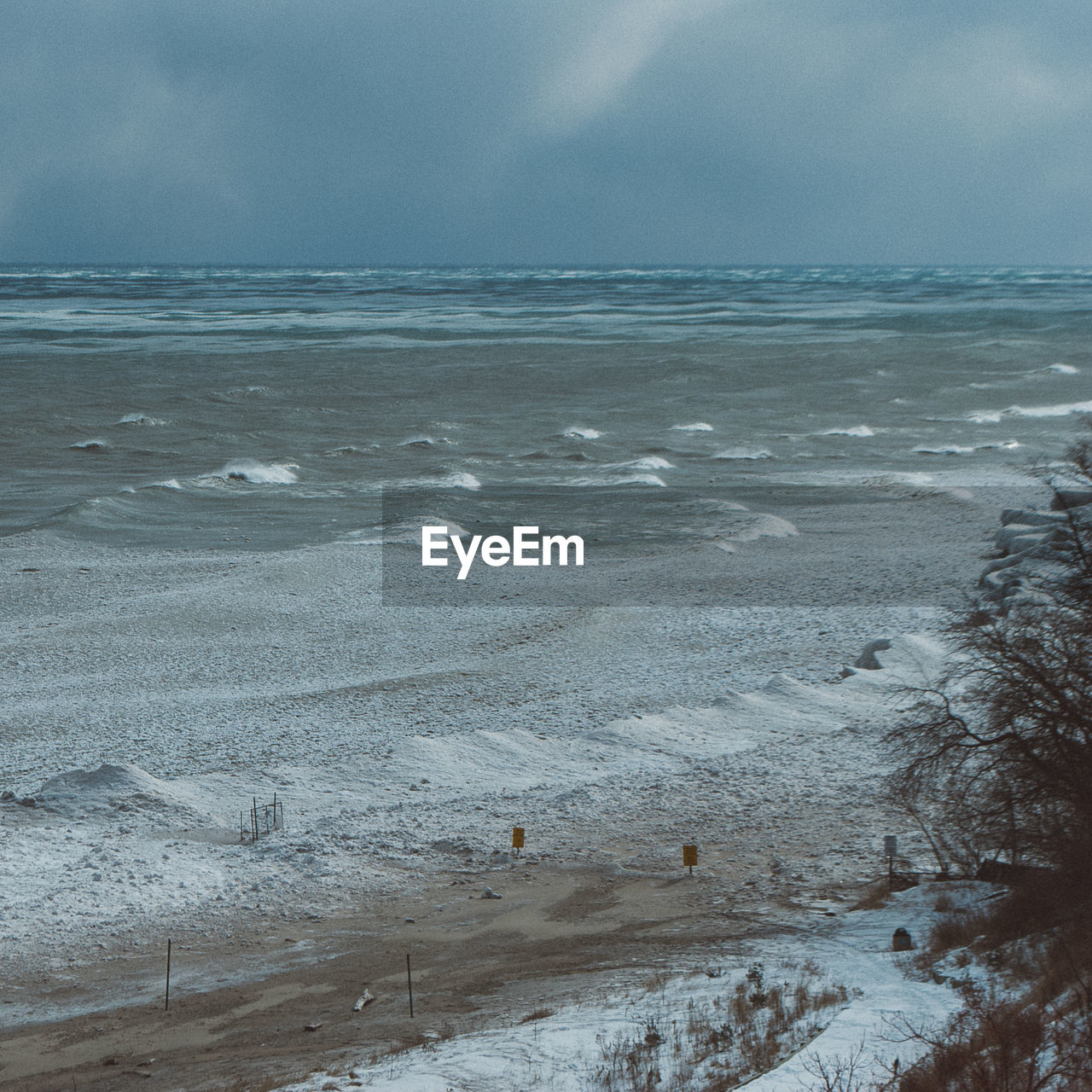 View of beach covered in snow