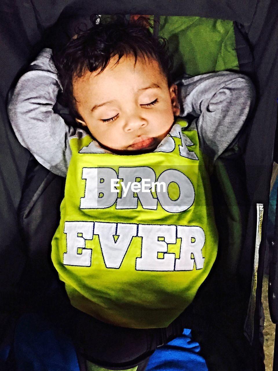 High angle view of boy sleeping in baby carriage