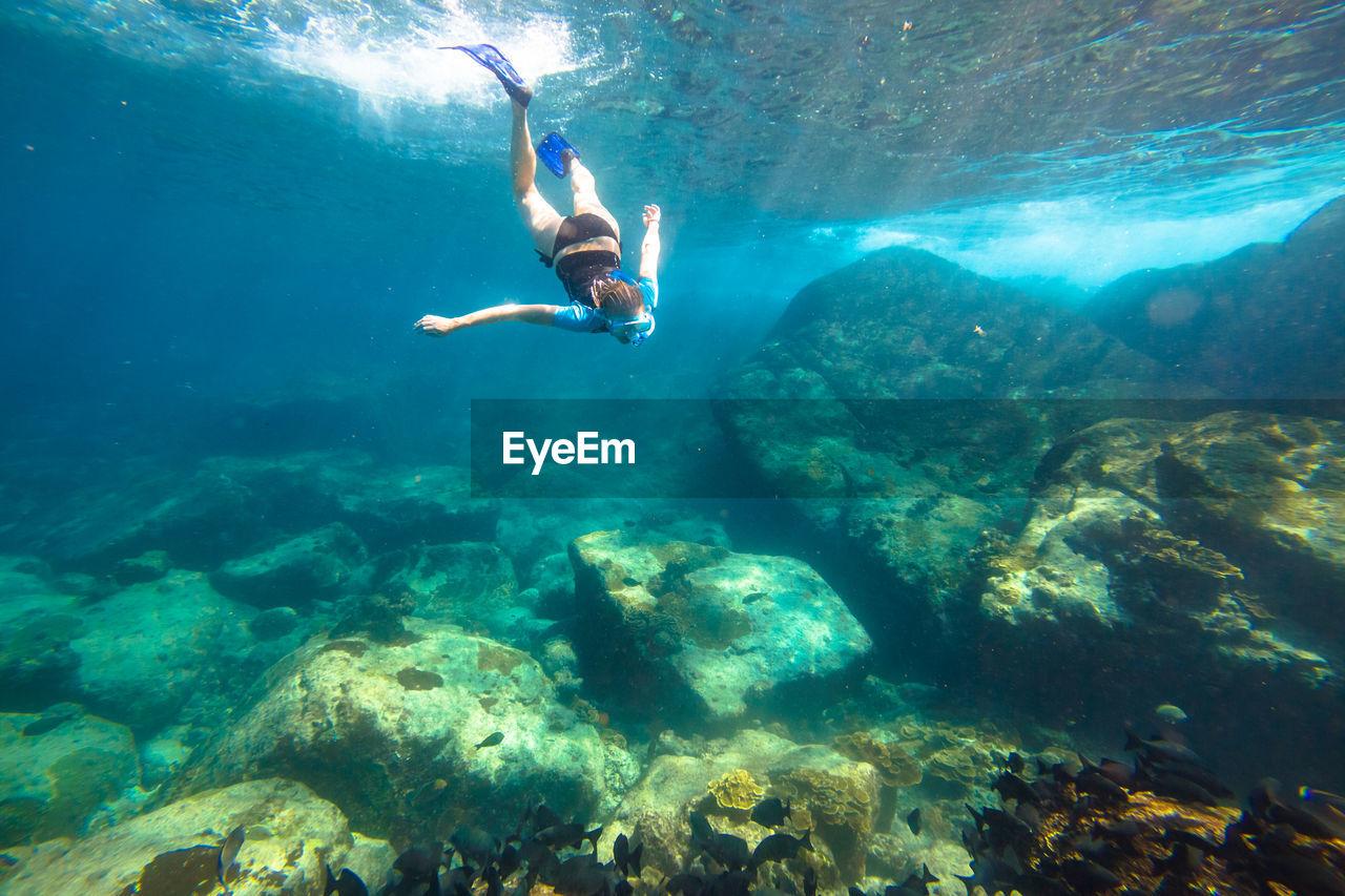 Woman swimming in sea
