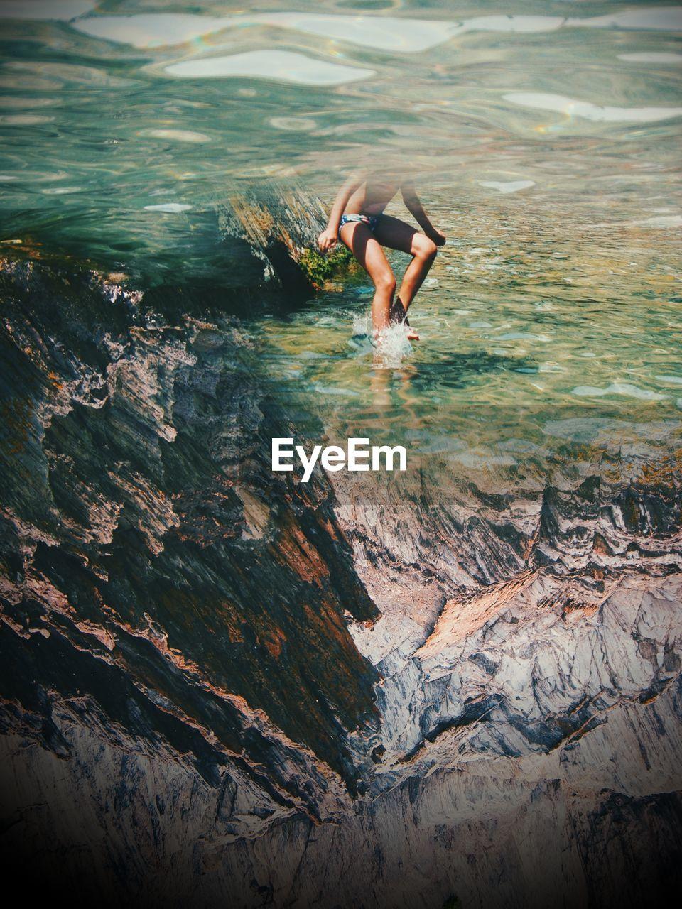 Childan jumping in sea