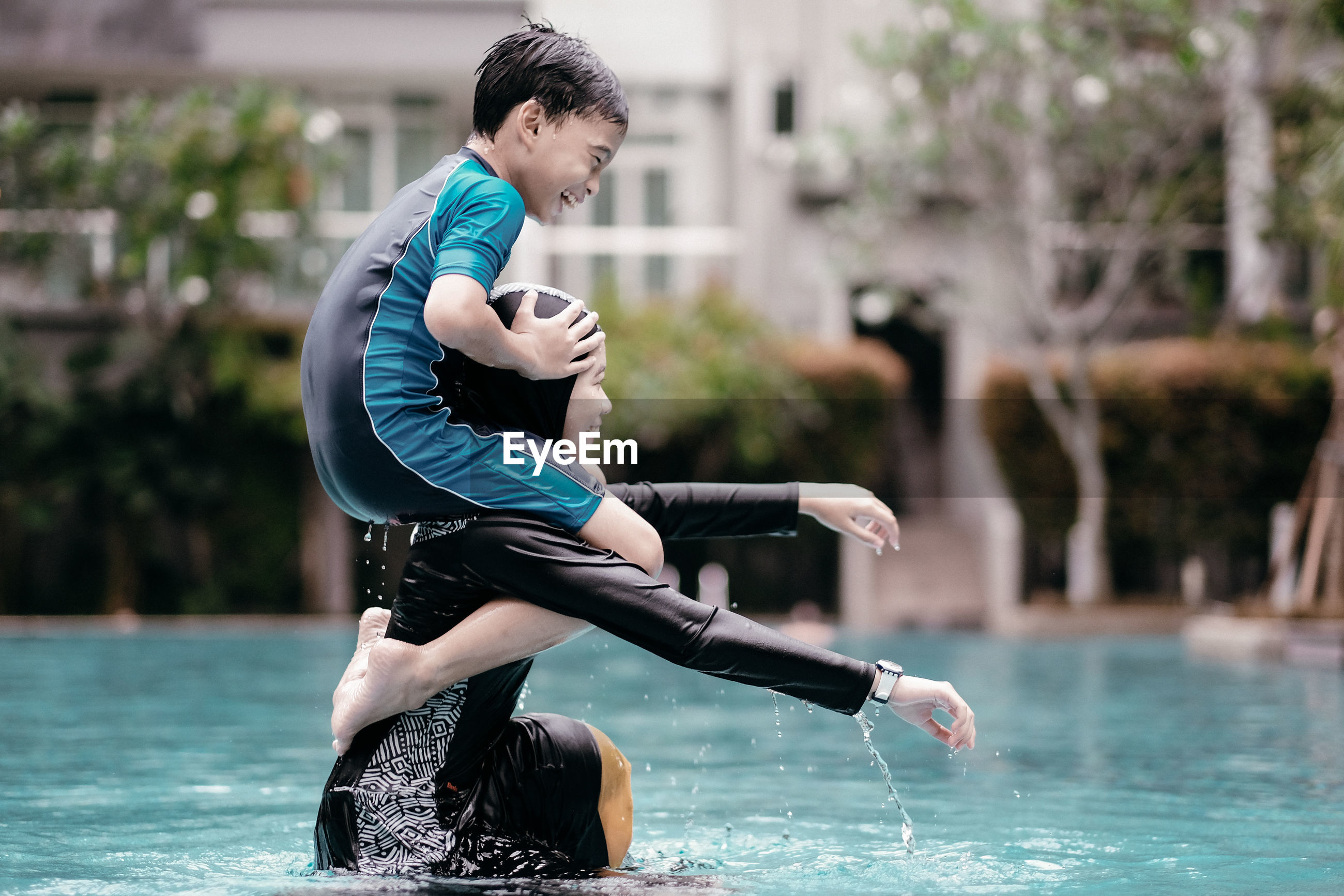 FULL LENGTH OF BOY WITH WATER